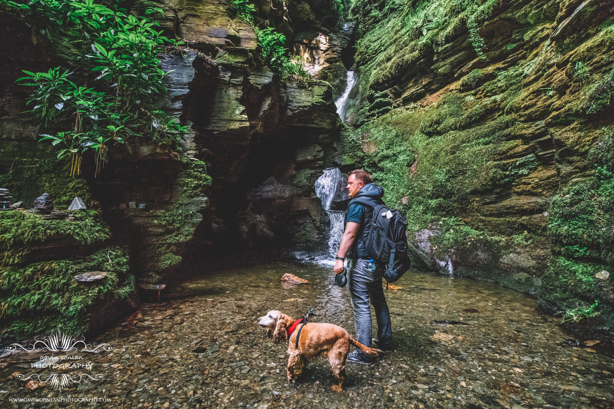 personal portrait of myself and my dog Holly standing in the waterfall at St Nectan's Glen in cornwall