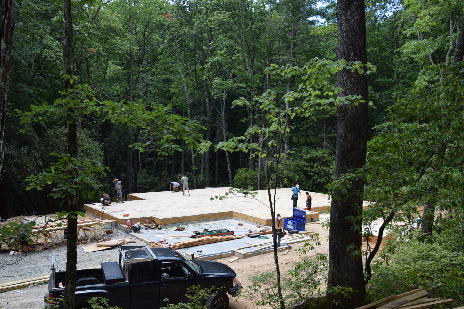Deck is installed on the foundation. Walls and rafters will come next.