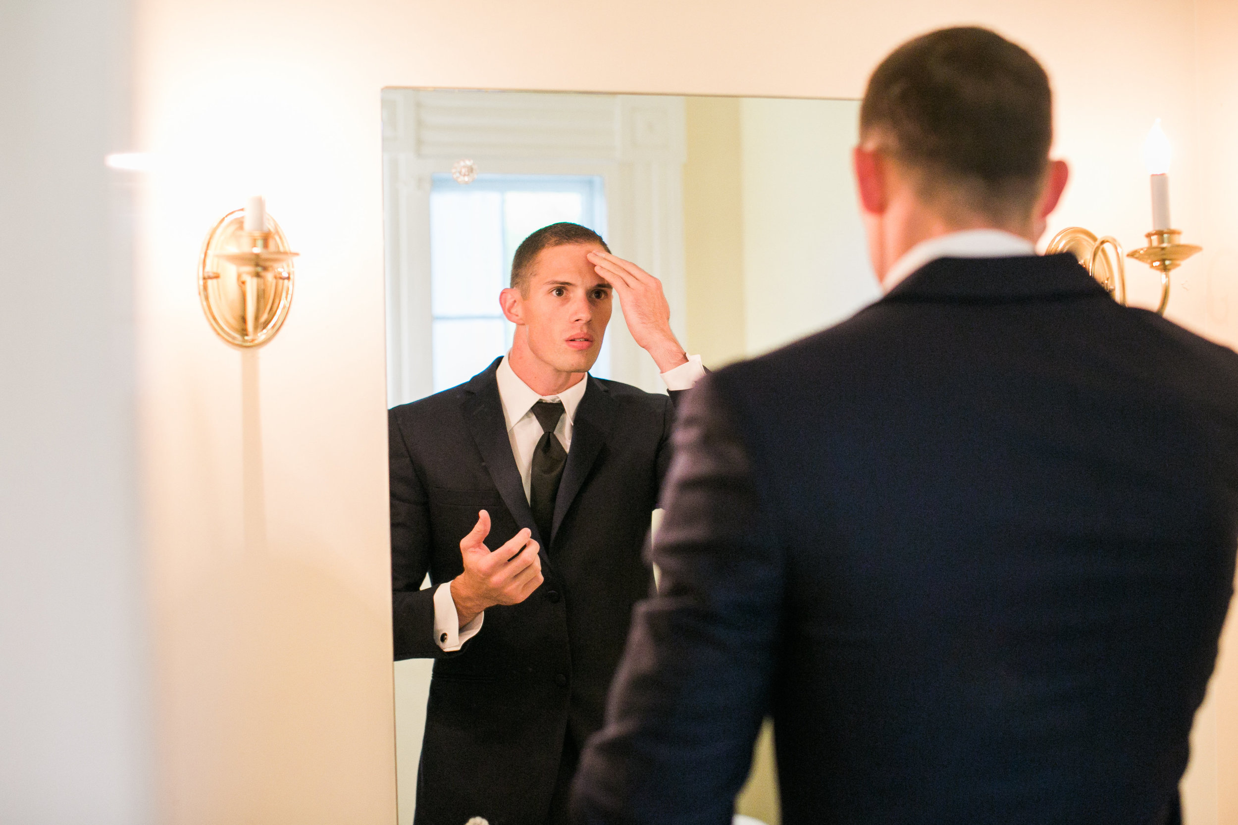 The Groom prepares for the day in his private dressing suite