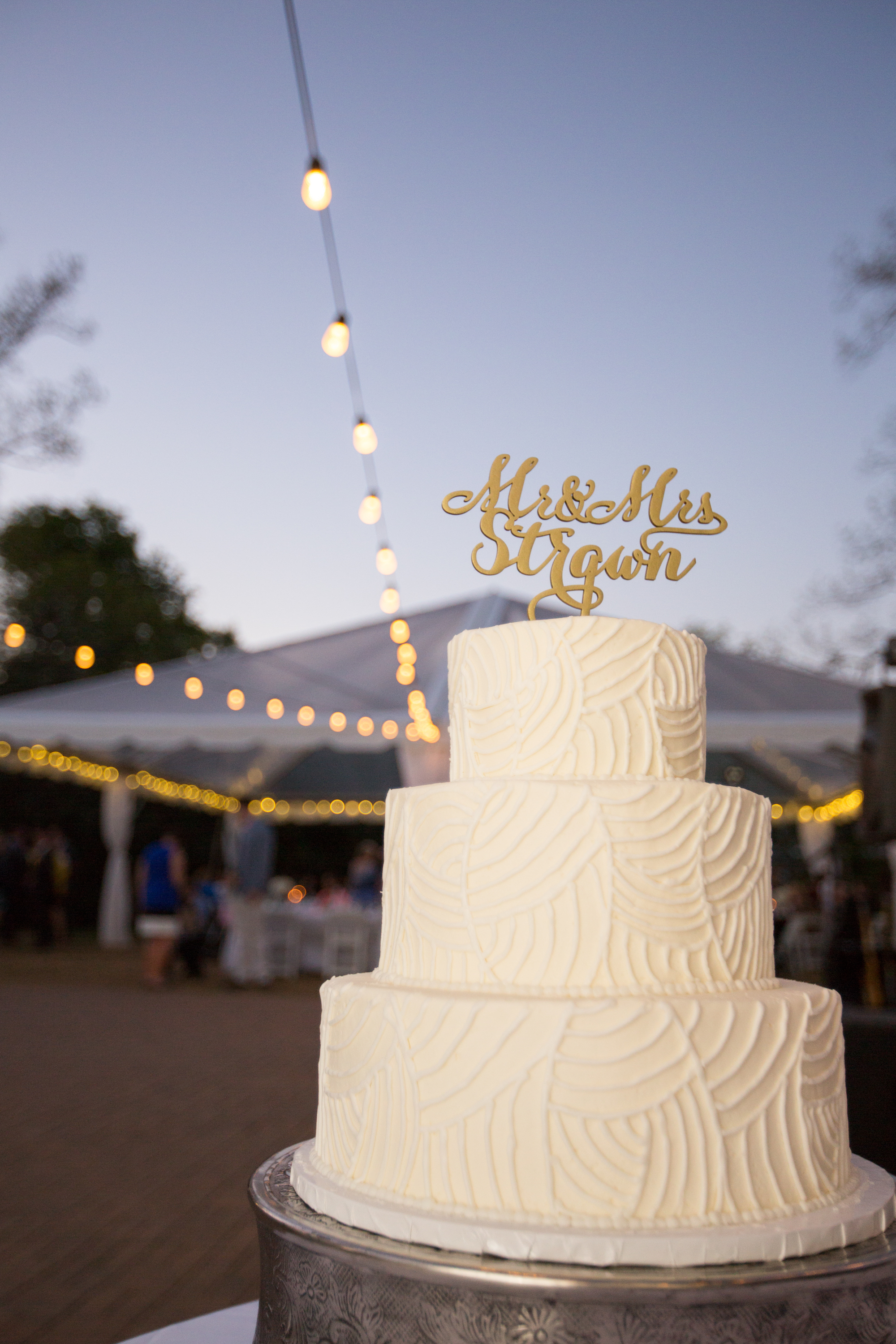 Watching the sun set over the party through the clear top tent via  Barron's Rental . Cake by  Classic City Confections