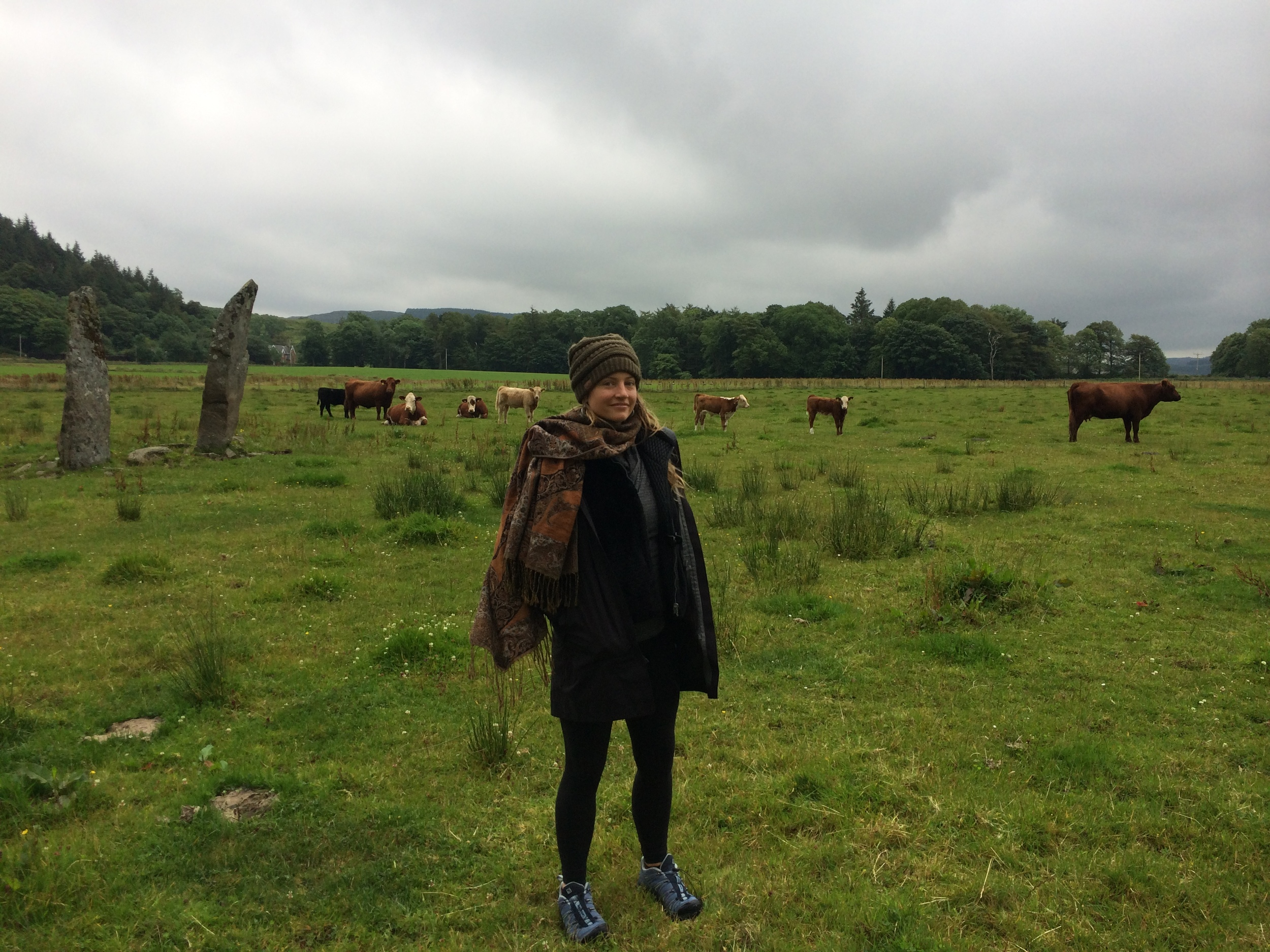 Me and an impressive circle of standing stones in a random cow field in Kilmartin.