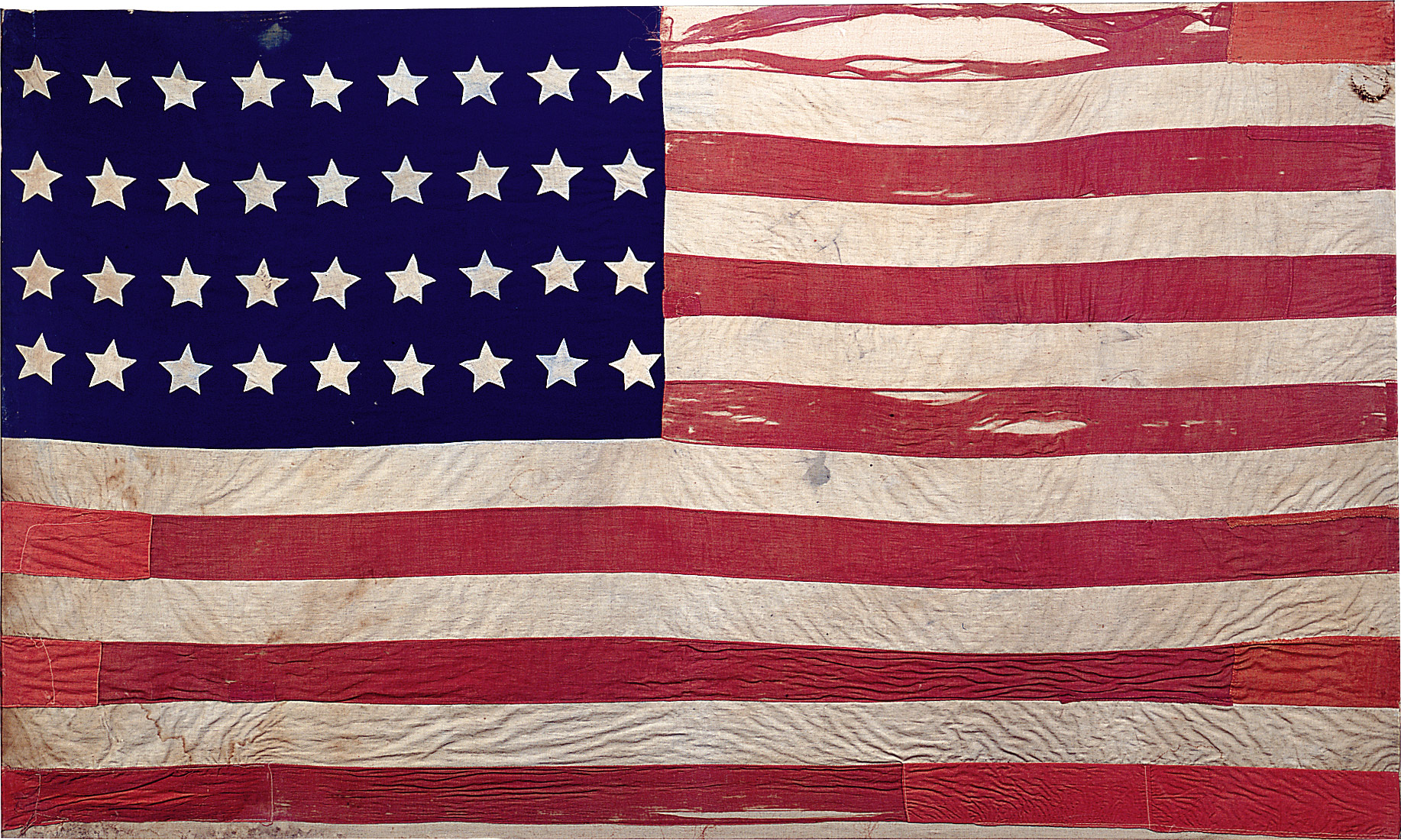 The Hinrichs family heirloom flag created by Ida Peppercorn in 1865.