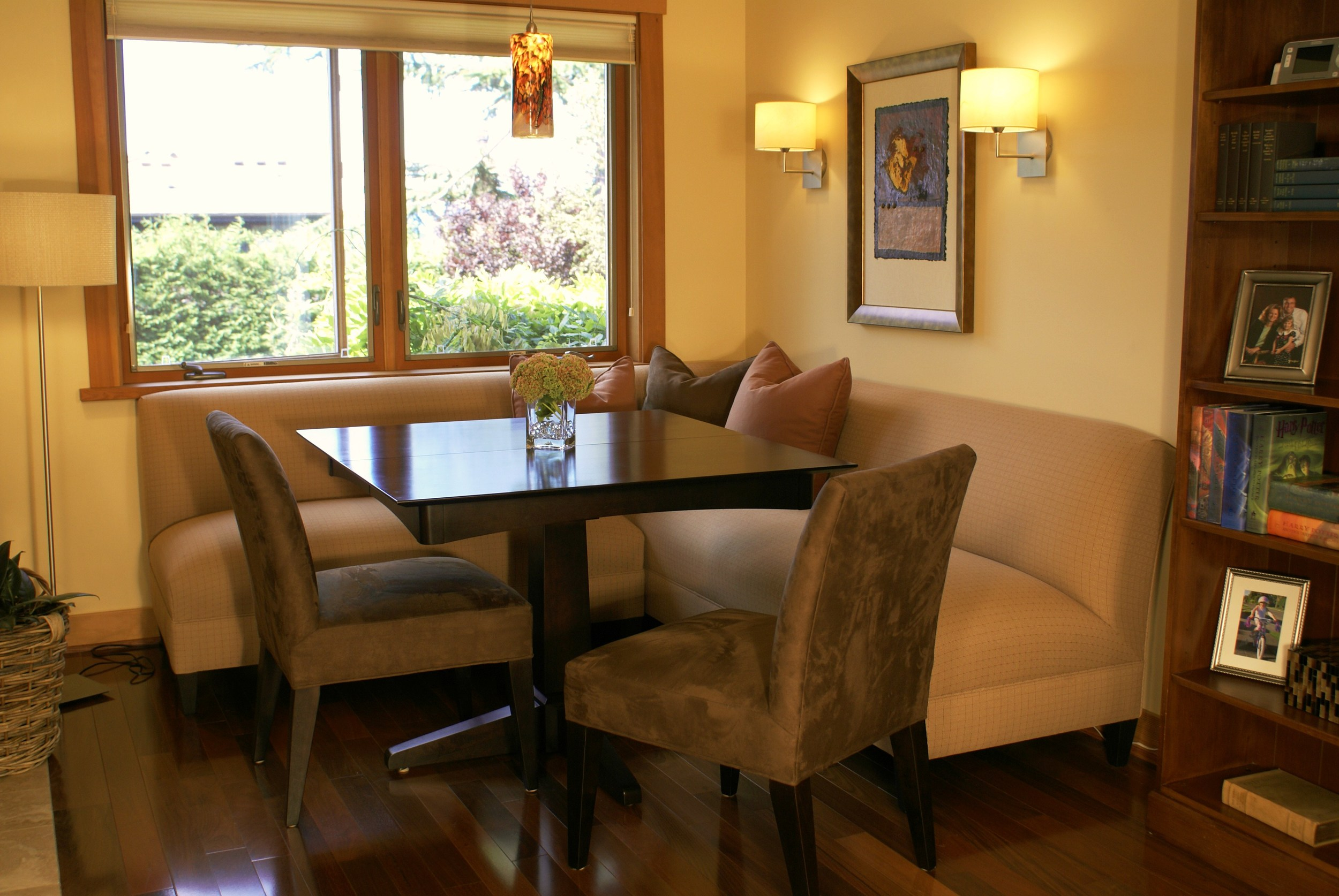 This space was featured in  Seattle Homes & Lifestyles Magazine  and had been used as a tiny family room. We designed the custom L-shaped banquette and upholstered it in a wonderful outdoor fabric. The new chairs are in easy-care ultrasuede. New light fixtures complete the mood.