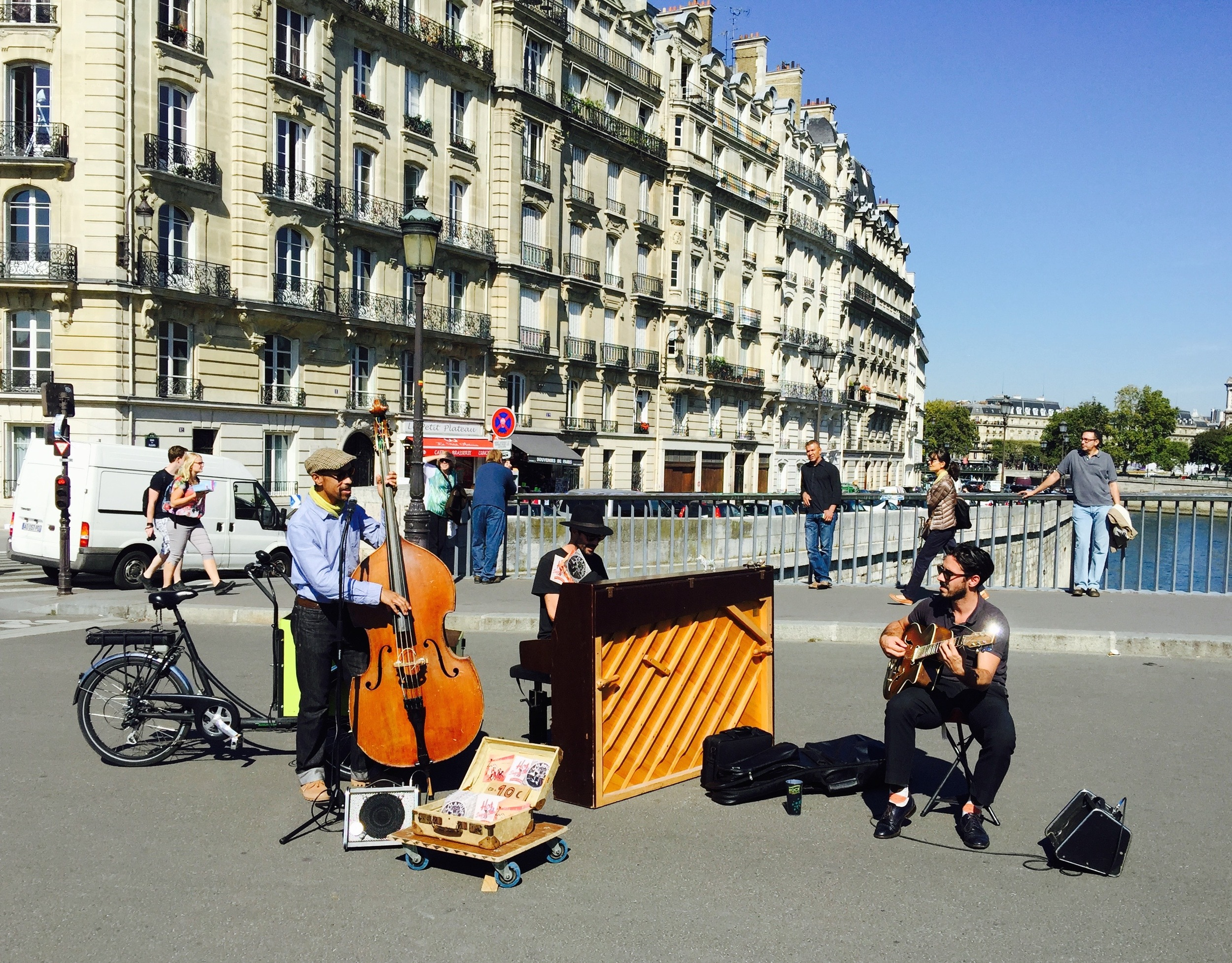 Just a few step from  Cafe St Regis  is a pedestrian-only bridge accross the Seine leading to Ile de la Cité and Notre Dame.  There are always musicians of one genre or another performing.   Ahhhhh......
