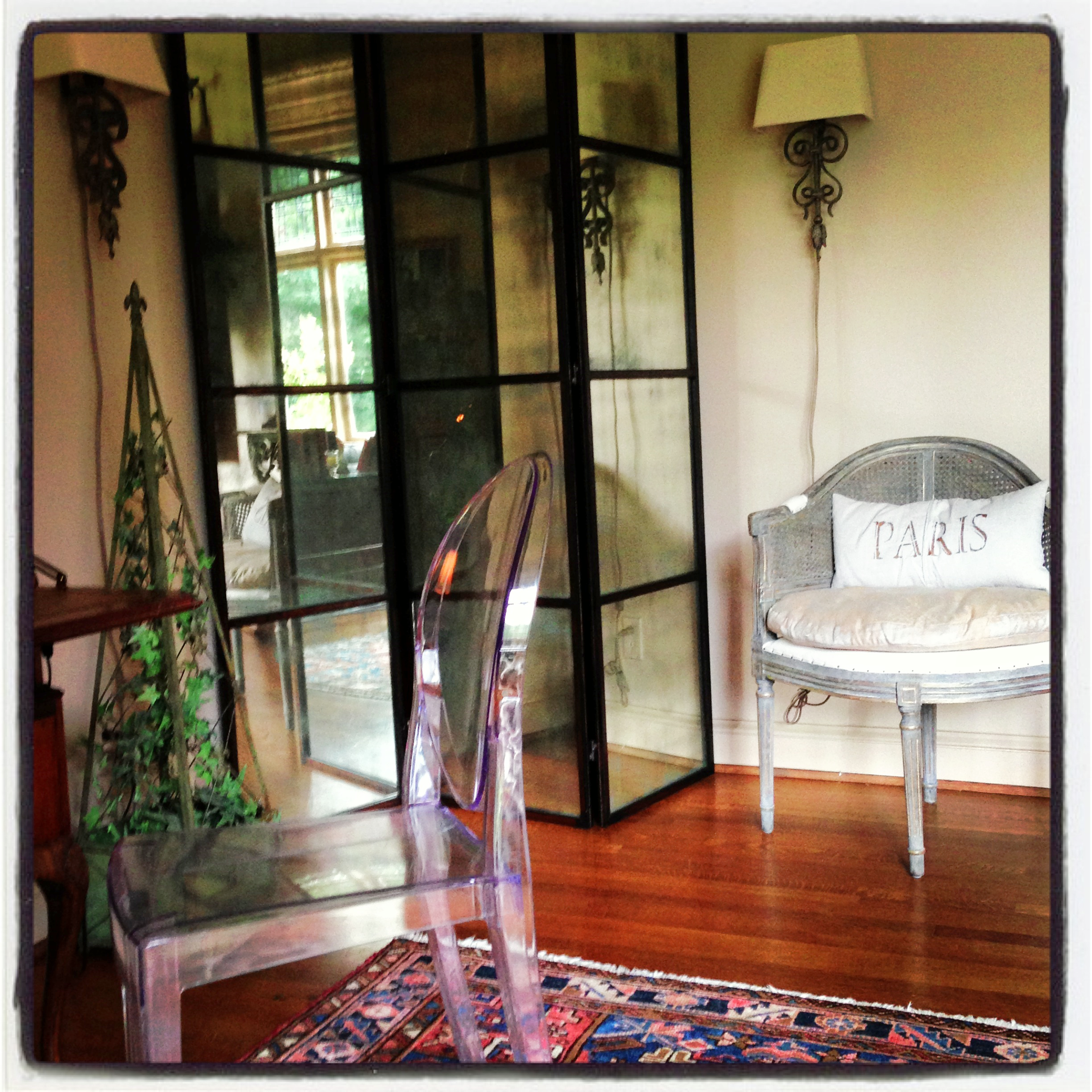 Philippe Starck Ghost Chair mixed with French reproductions and antique Oriental rug