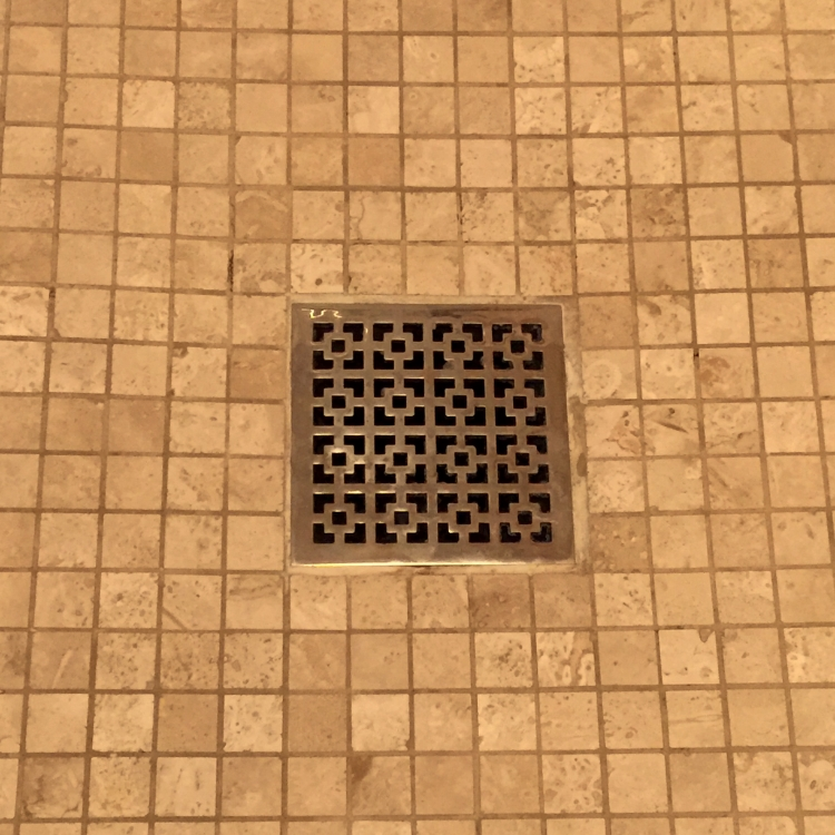 Love this decorative drain cover!