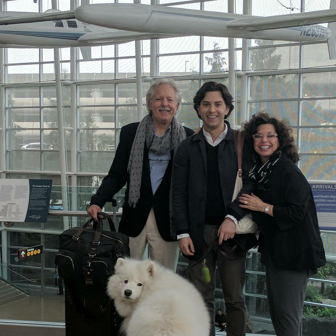 Saying goodbye to Nick at the airport. We're smiling to keep from crying.
