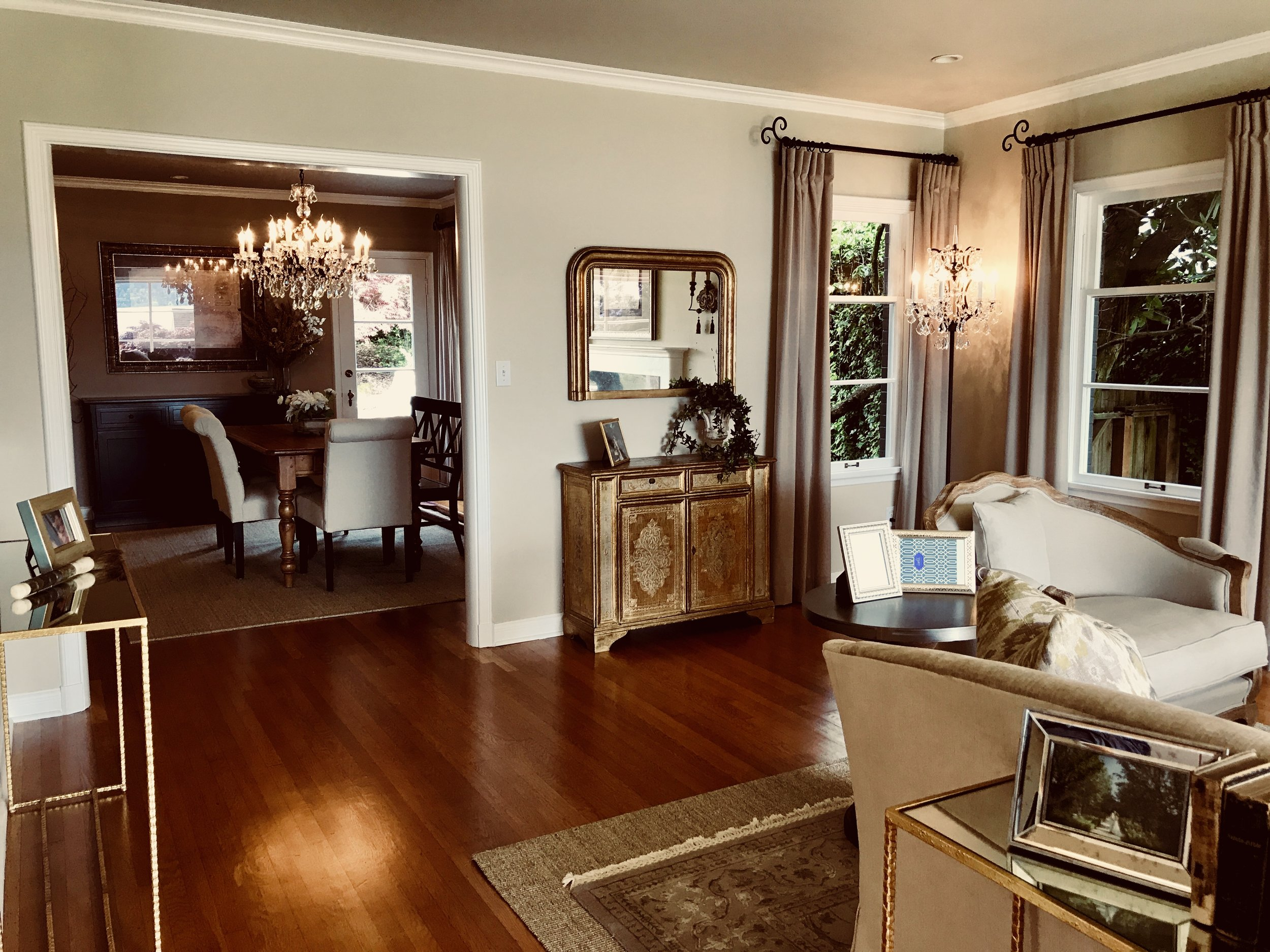 A painted Italian cabinet and Louis Philippe mirror add European charm