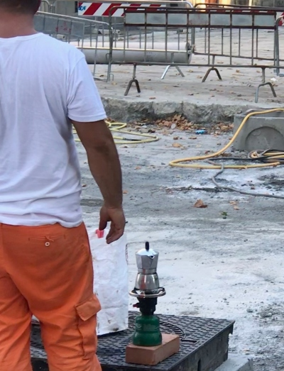 We watched the re-paving of the street in front of our piazza beginning in April. By July, it was awfully hot in the street. This fellow makes his own coffee break!