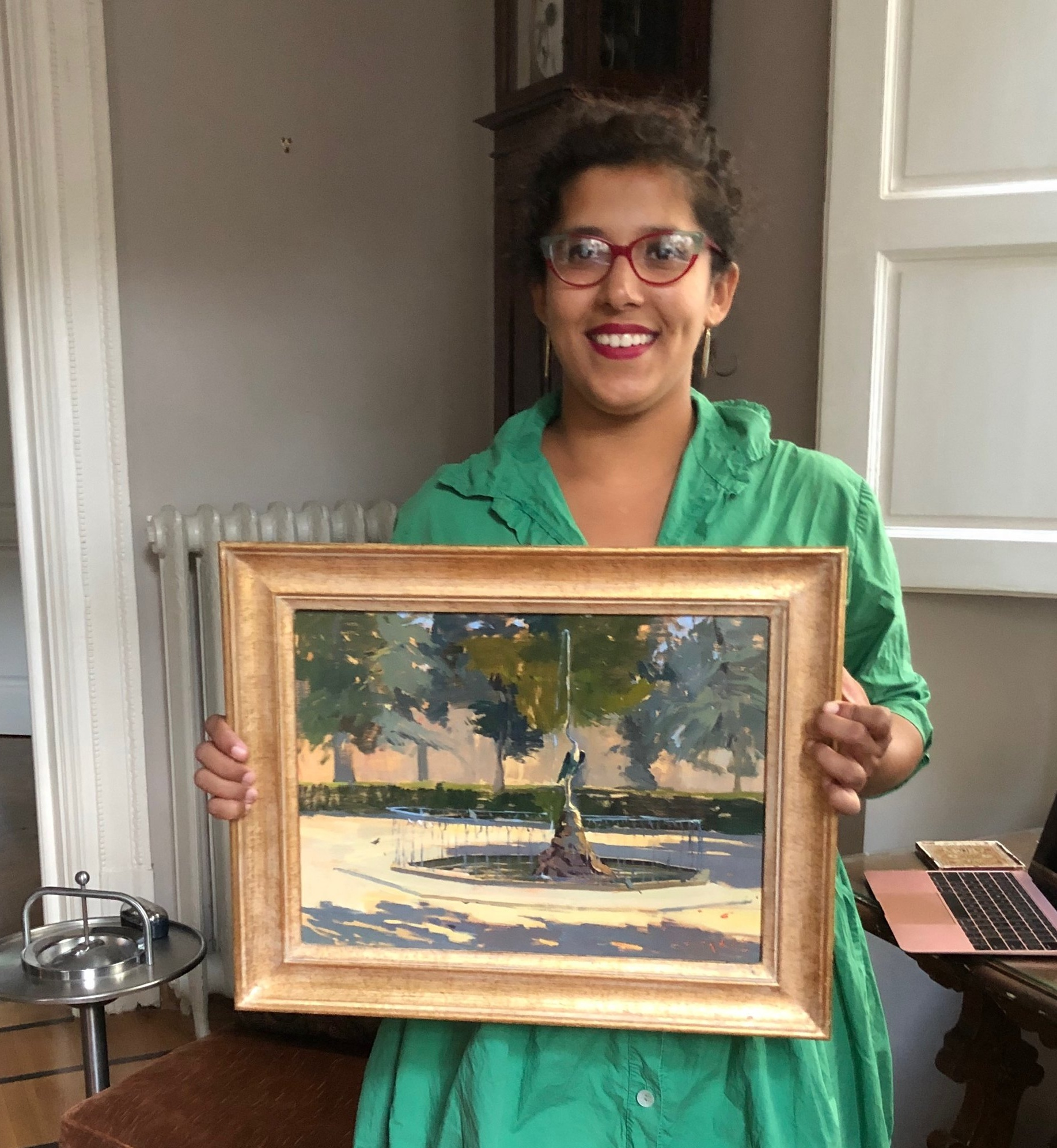Tanvi Pathare with her framed painting of the fountain in our park