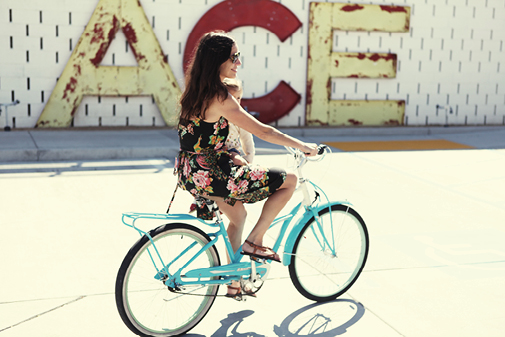 PSP-HOME-ace_sign_girl_on_bike_with_child_20130719_1613.png