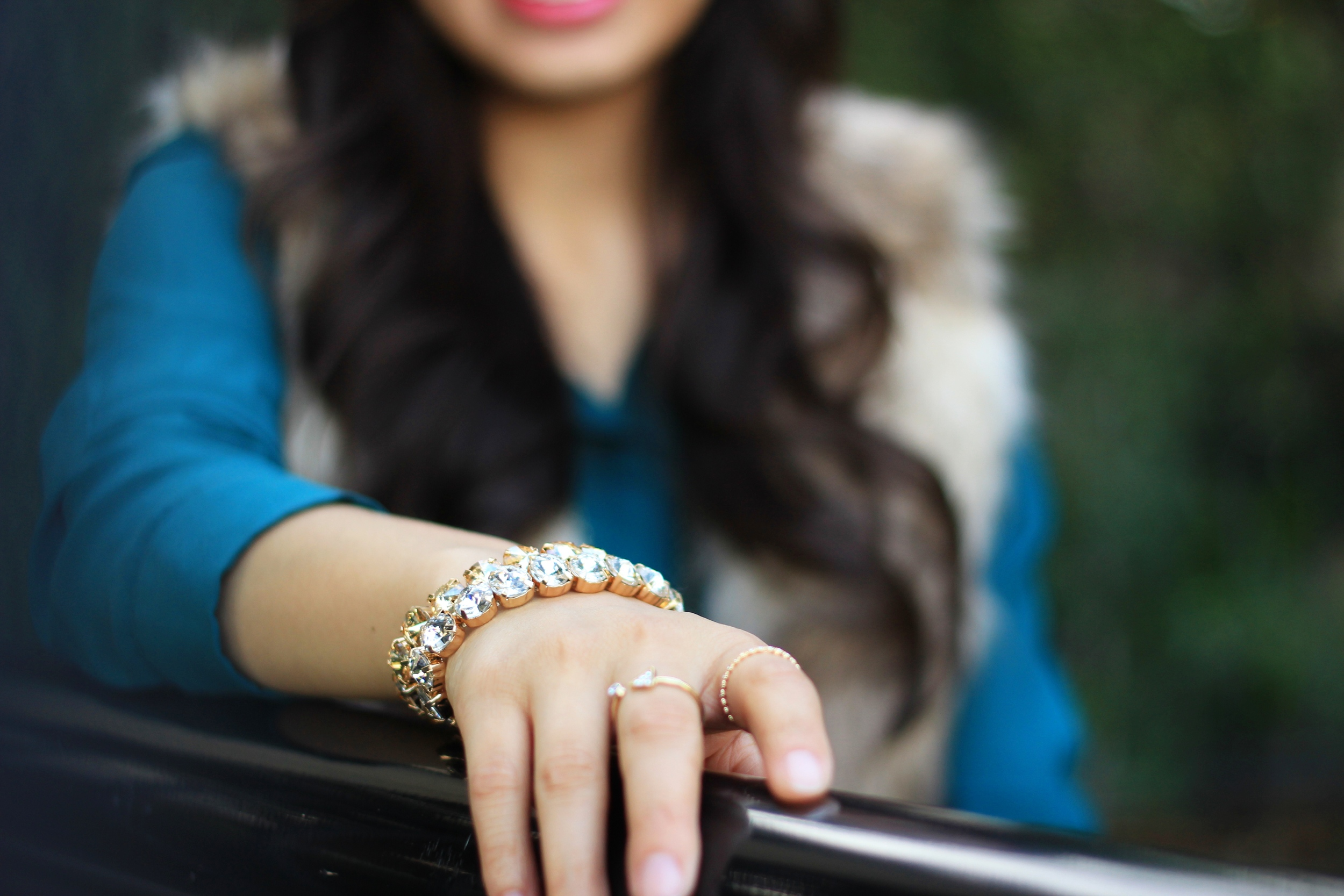Fall fashion with faux fur vest, booties, and statement jewelry from The Dot online jewelry shop