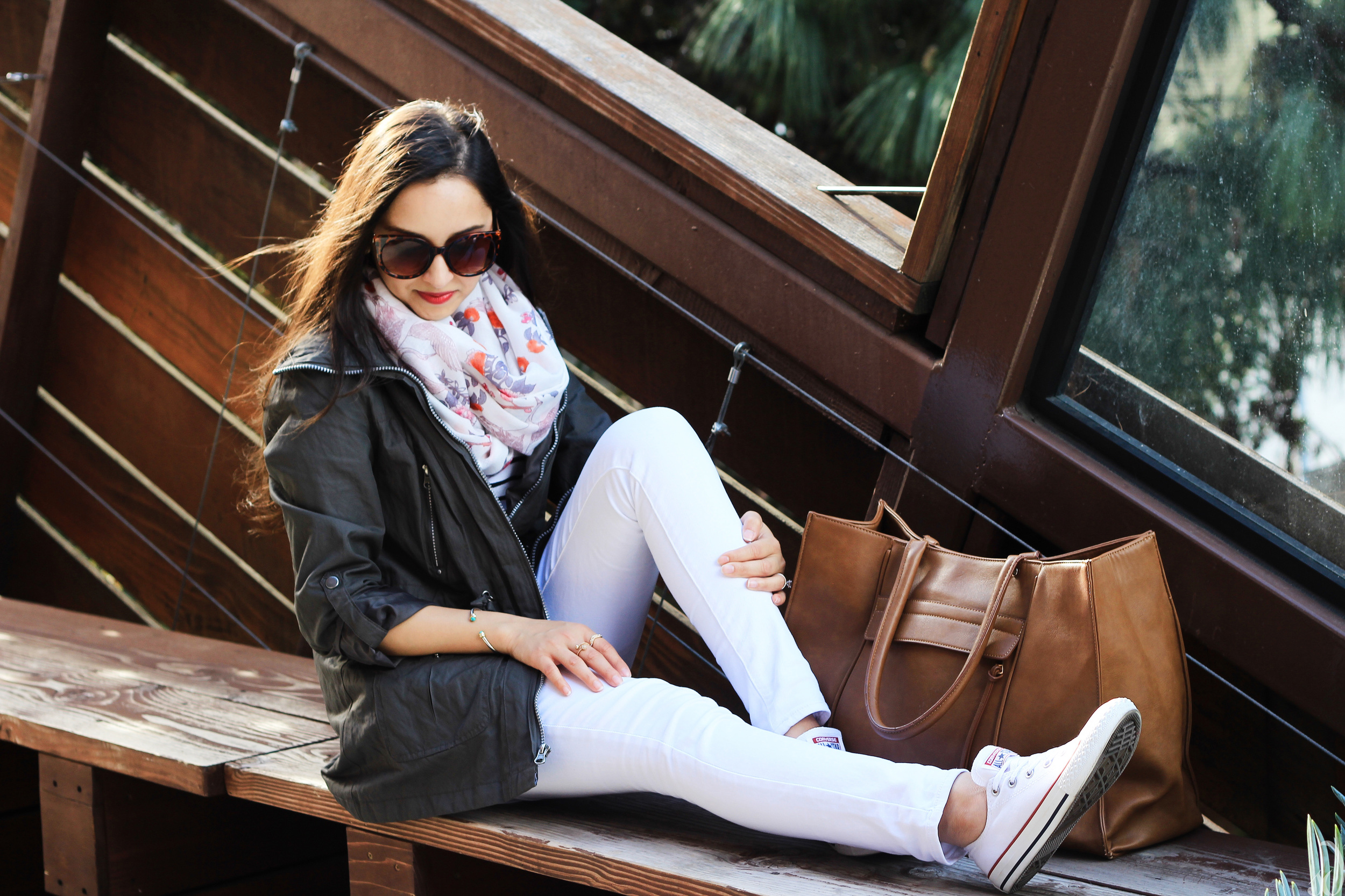 white pants, converse, utility jacket, olive green, brown tote, floral scarf, vacation style, road trip style