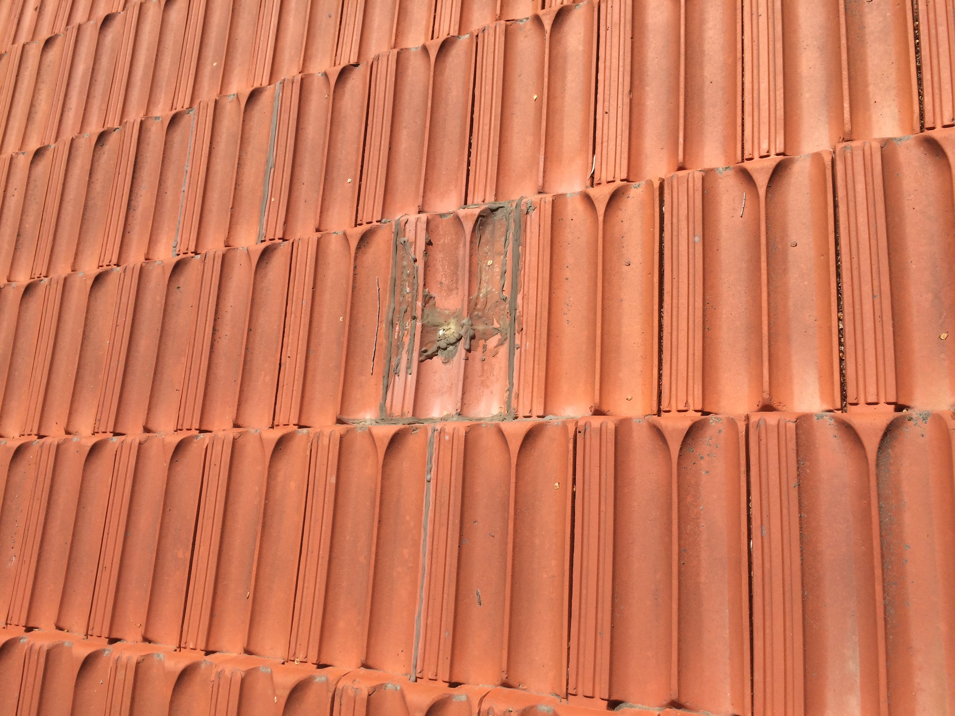 Leaking clay tile roof