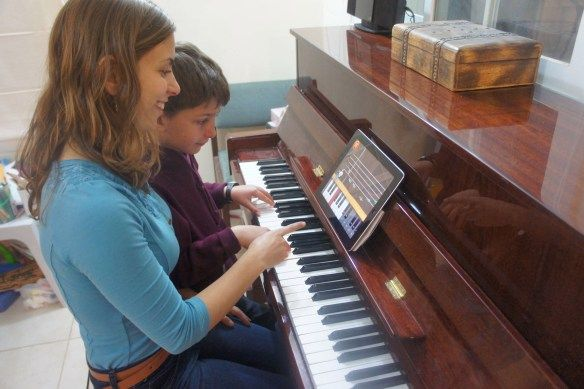child getting piano lesson.jpg