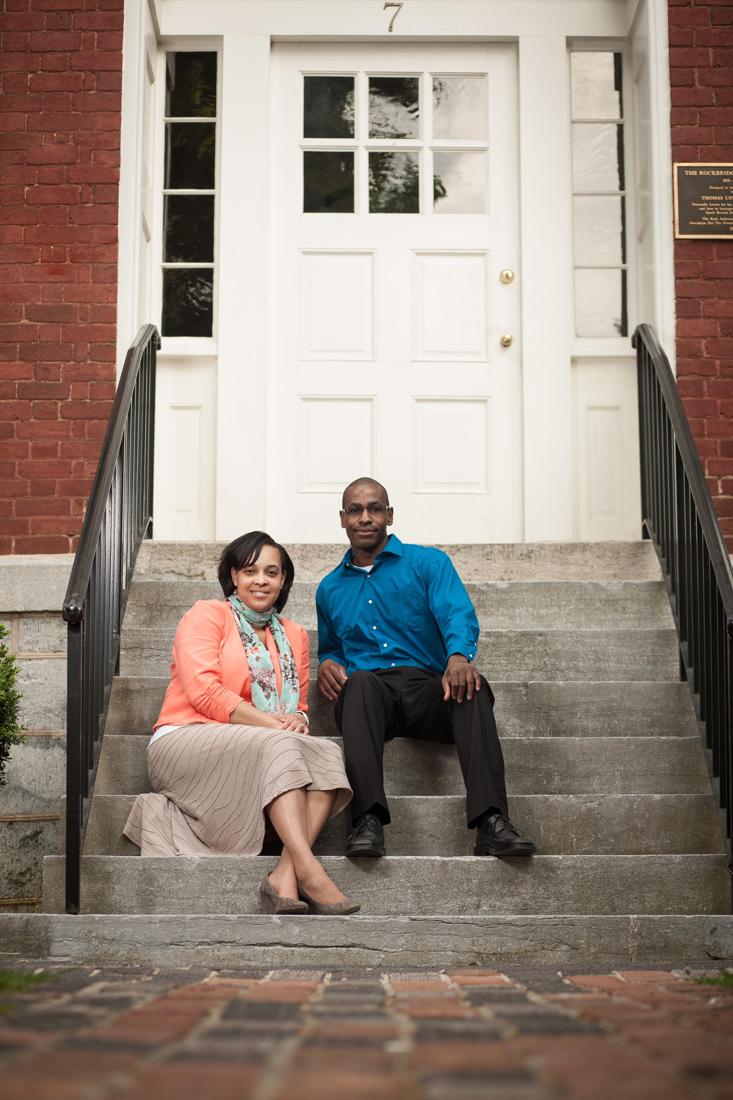 Engaed couple posed on stairs in Lexington, Virginia