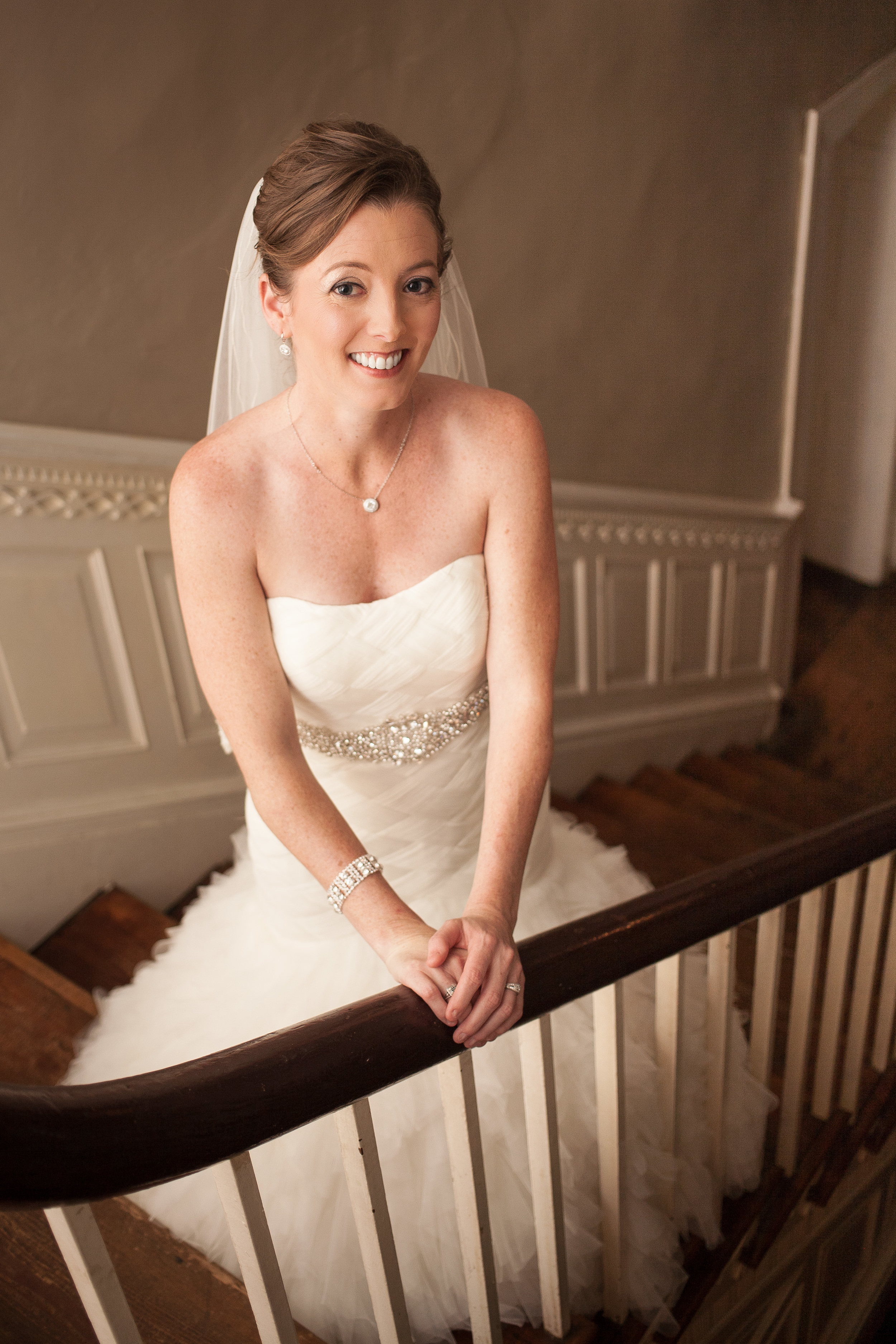 wedding photographer Bent-Lee Carr The Kyle House Fincastle Virginia smiling bride on staircase soft light warm light