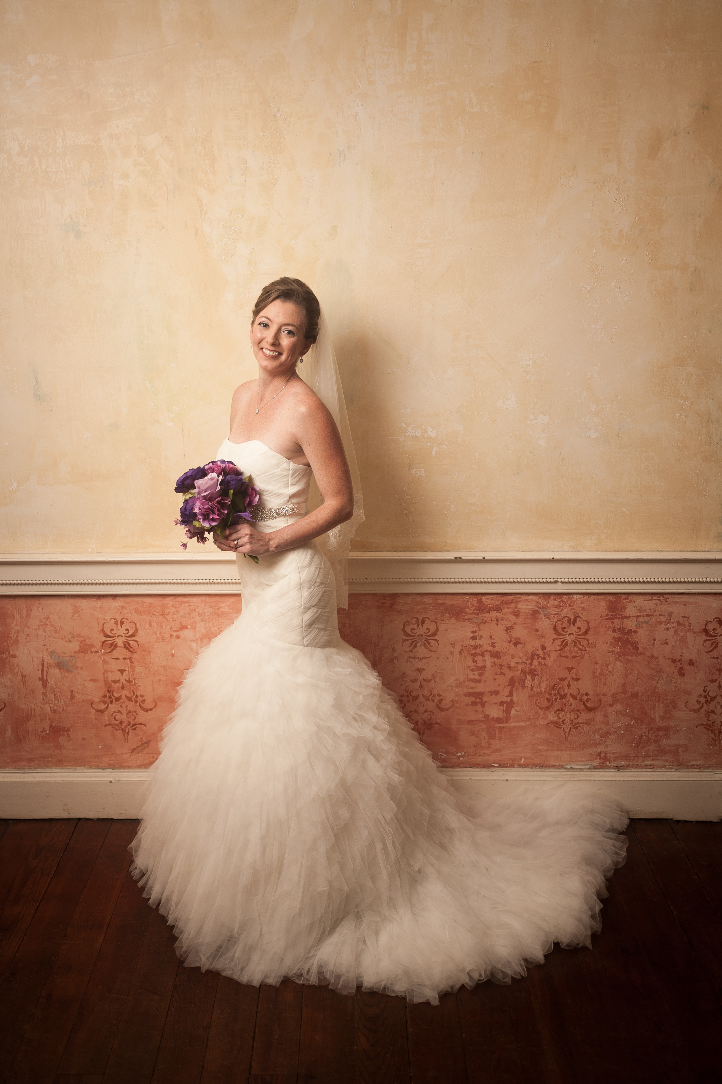 wedding photographer bent-lee carr bride in front of amazing textured wall at the kyle house in fincastle virginia