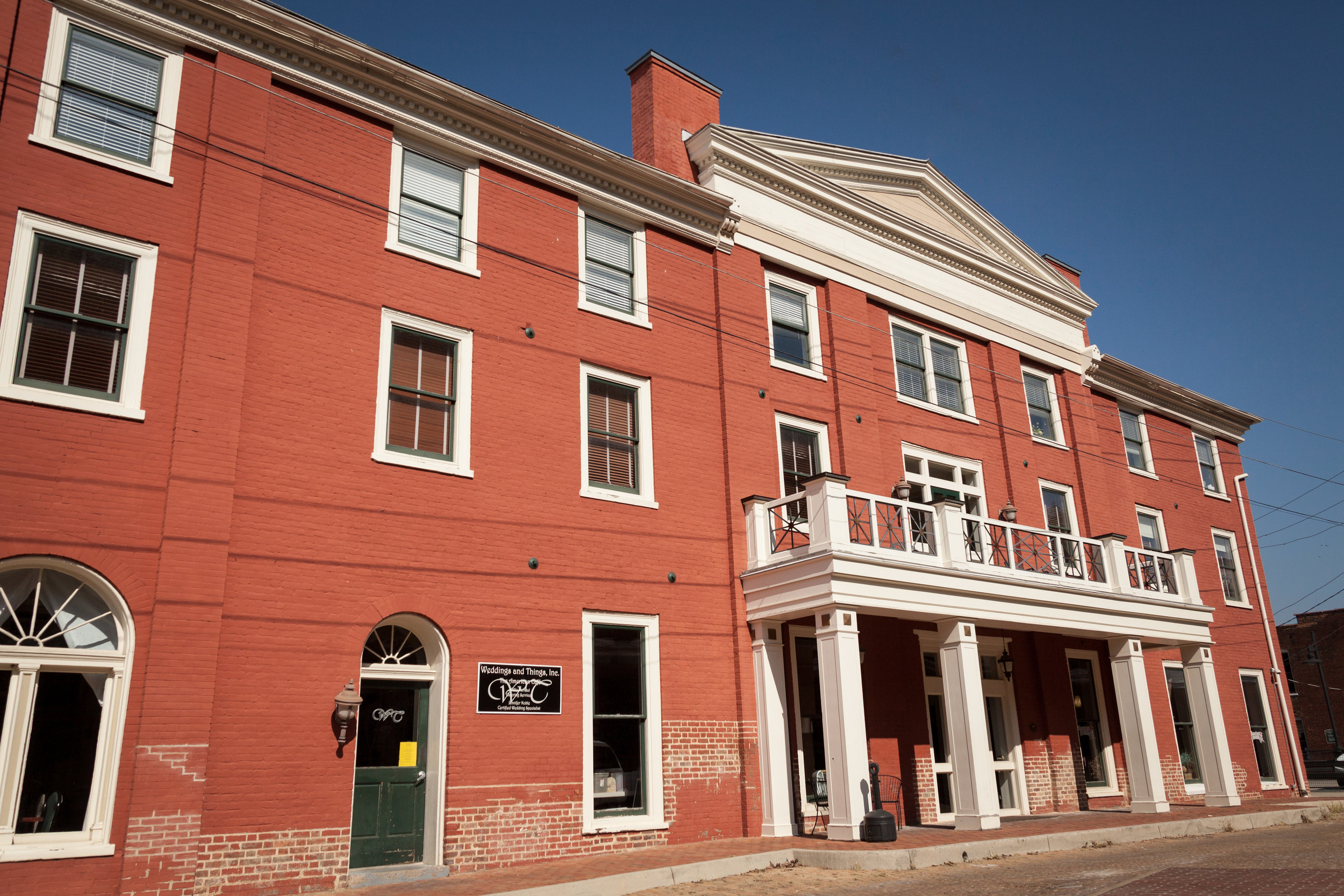 Wedding at the American Hotel in Staunton, Virginia. Shot of the exterior brick and blue sky