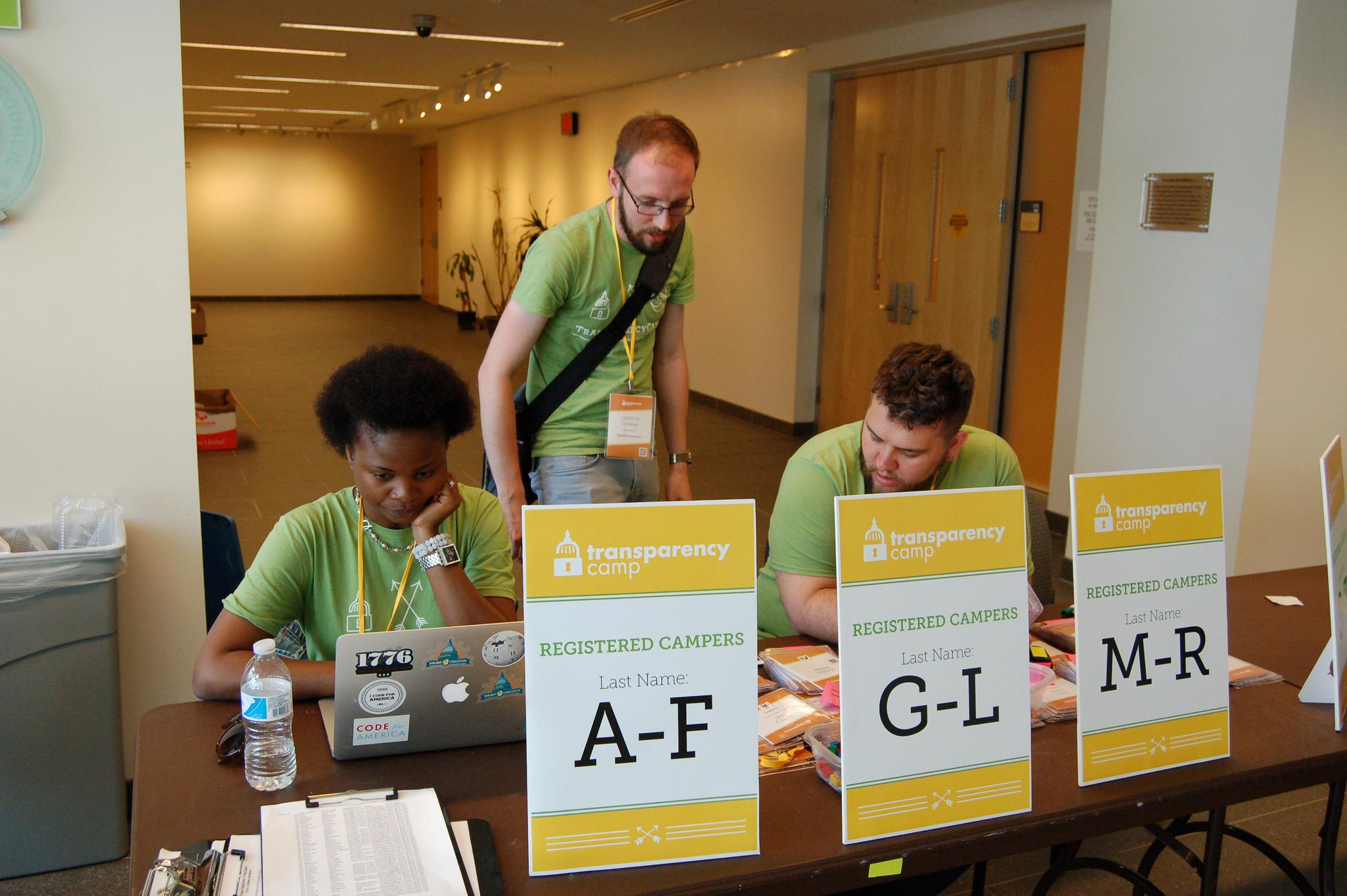 Registration desk signage helped people find their badges quickly