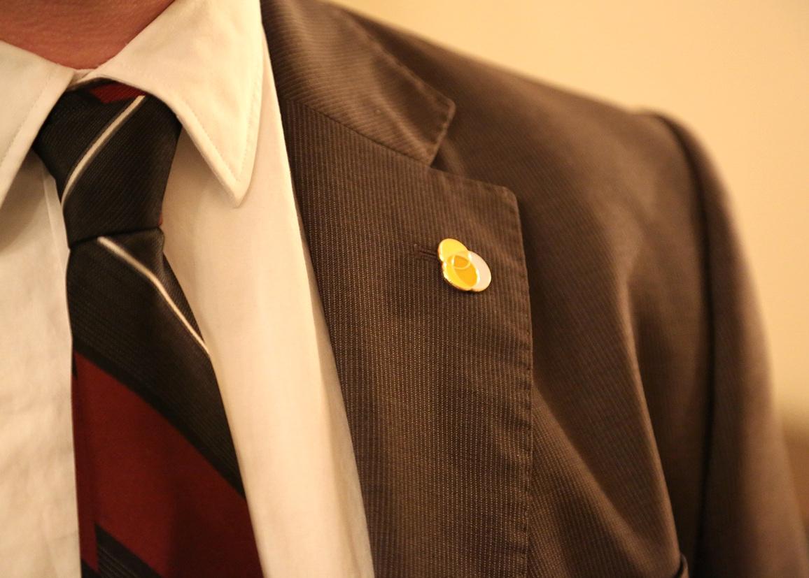 Sunlight Foundation lapel pin on a staff member's blazer