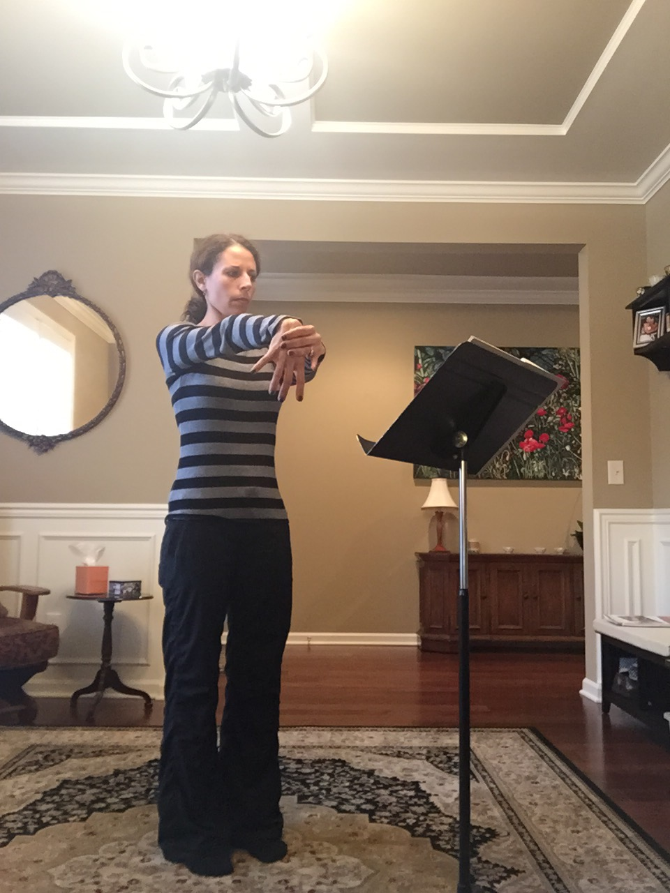 This week I'm practicing for the Knoxville Opera's production of HMS Pinafore. It's important for flutists to stretch their wrists!