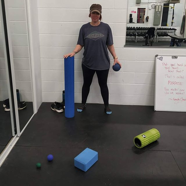 Sam using ALLLL the tools!  One of the beauties of having my own gym is that I can justify buying the exact right mobility tools for each application... Sure you can get away with just a foam roll and a lacrosse ball, but it's pretty awesome being able to select the perfect tool for each specific muscle!  P.s. shoutout to Sam for doing split squats with 2 35lb dumbbells today! This lady is getting STRONG!  #RuthlesslyPositive #NoExcuses