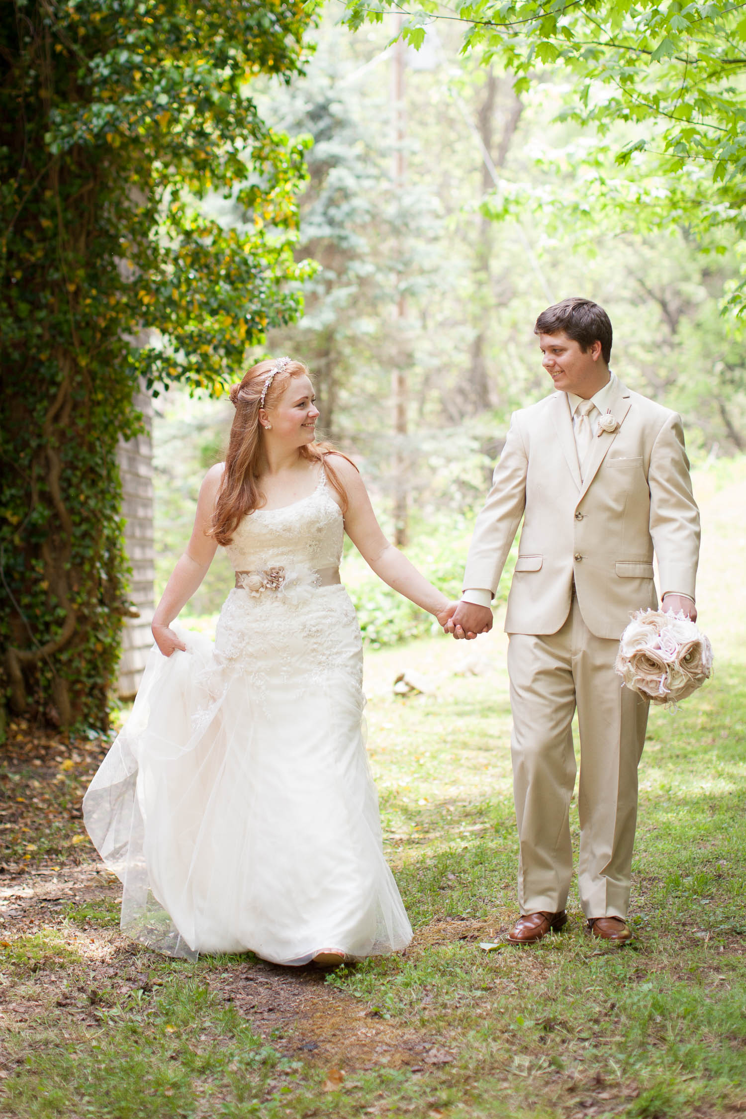 Kelsey and David got married at the historic Church of the Little Flower in the mountains of WNC. This image was taken just after the ceremony as they walked hand in hand through a grassy area just outside the chapel. I just love the dreamy atmosphere that the back lit sun along with the bright pastel colors of Spring provide.