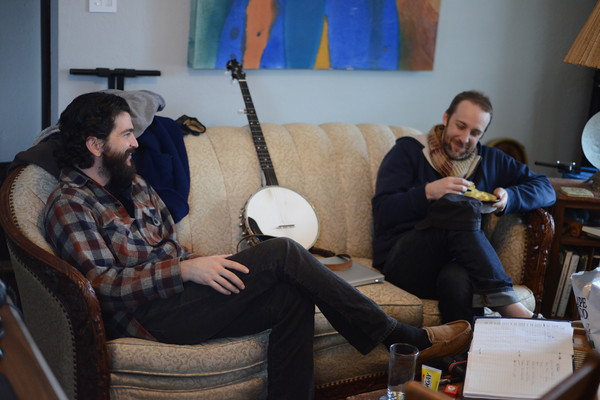 Nick and Eric cracking up with snacks and banjo