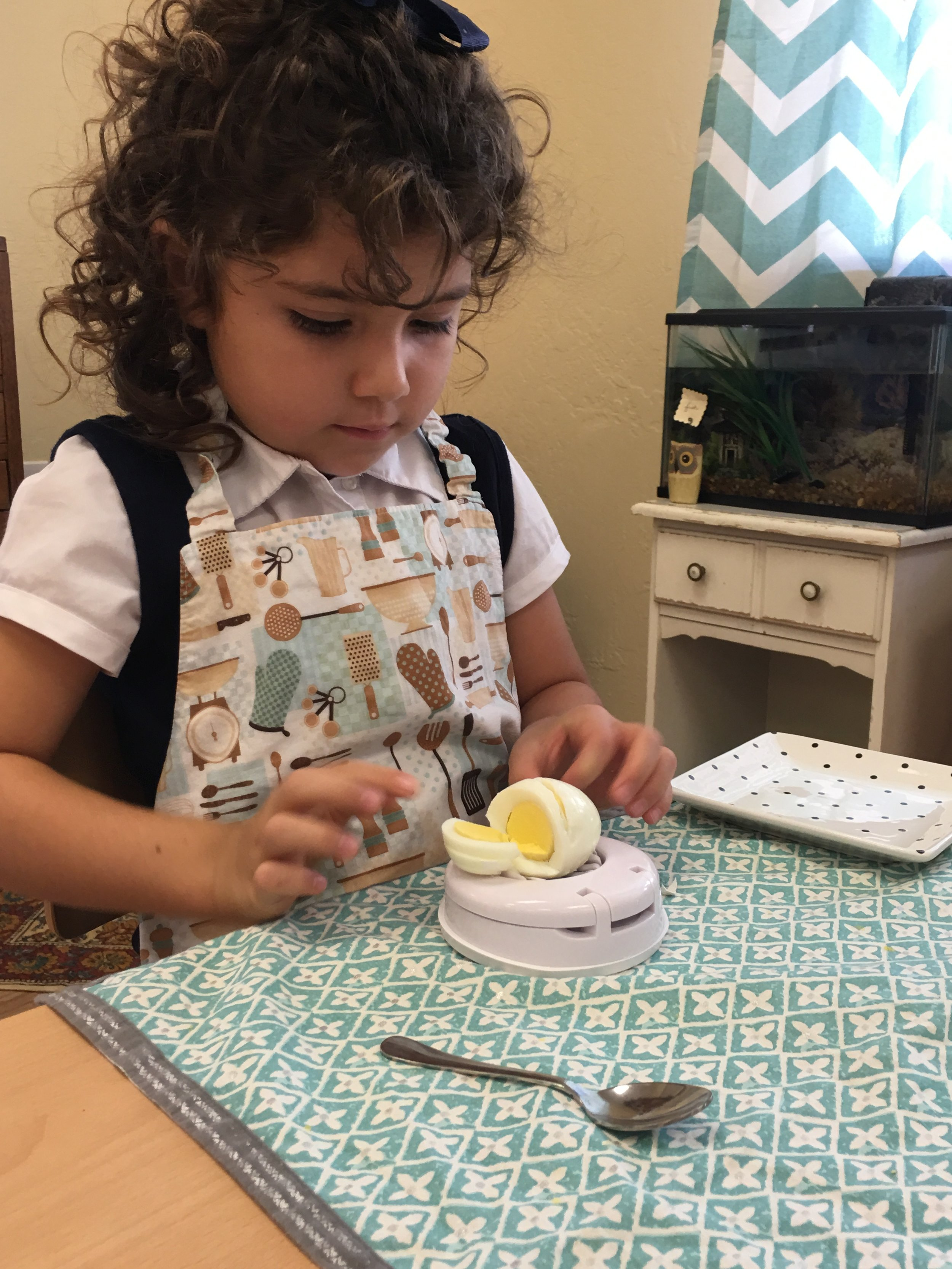 A child doing the egg work