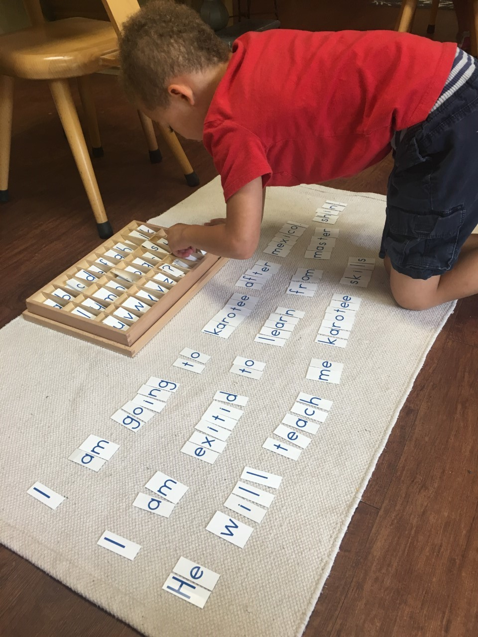 The child is expressing himself through written language.