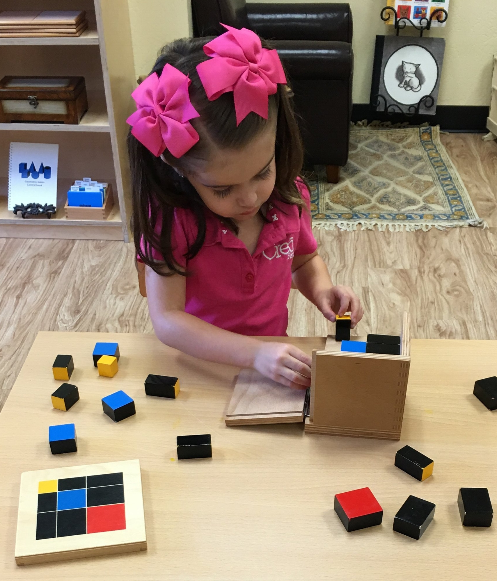 A child working with the trinomial cube