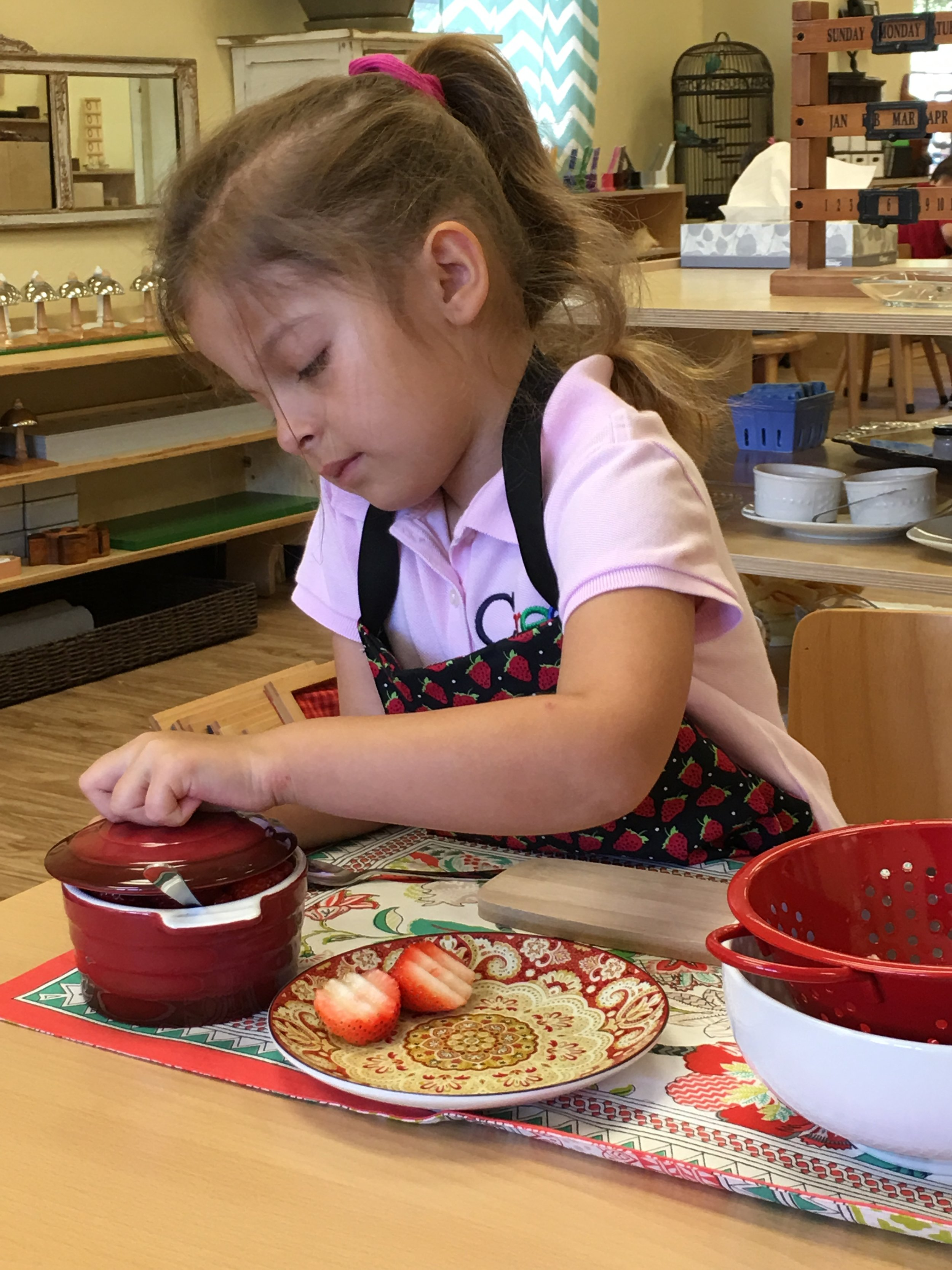 Slicing strawberries to share during snack time