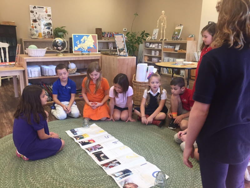 A child telling her story to her friends using a timeline