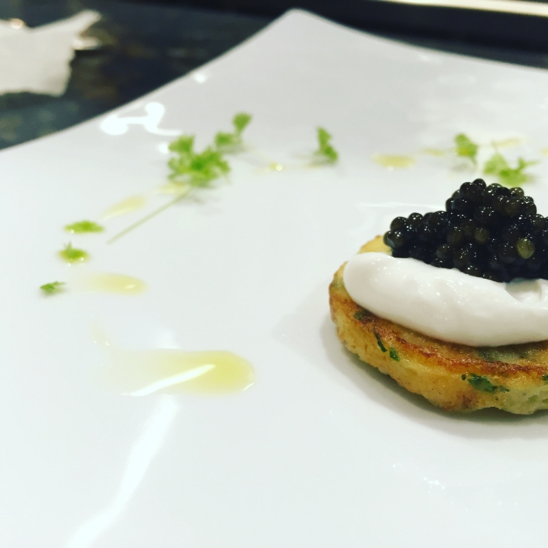 Potato blini with buttermilk whipped ricotta top with Osetra