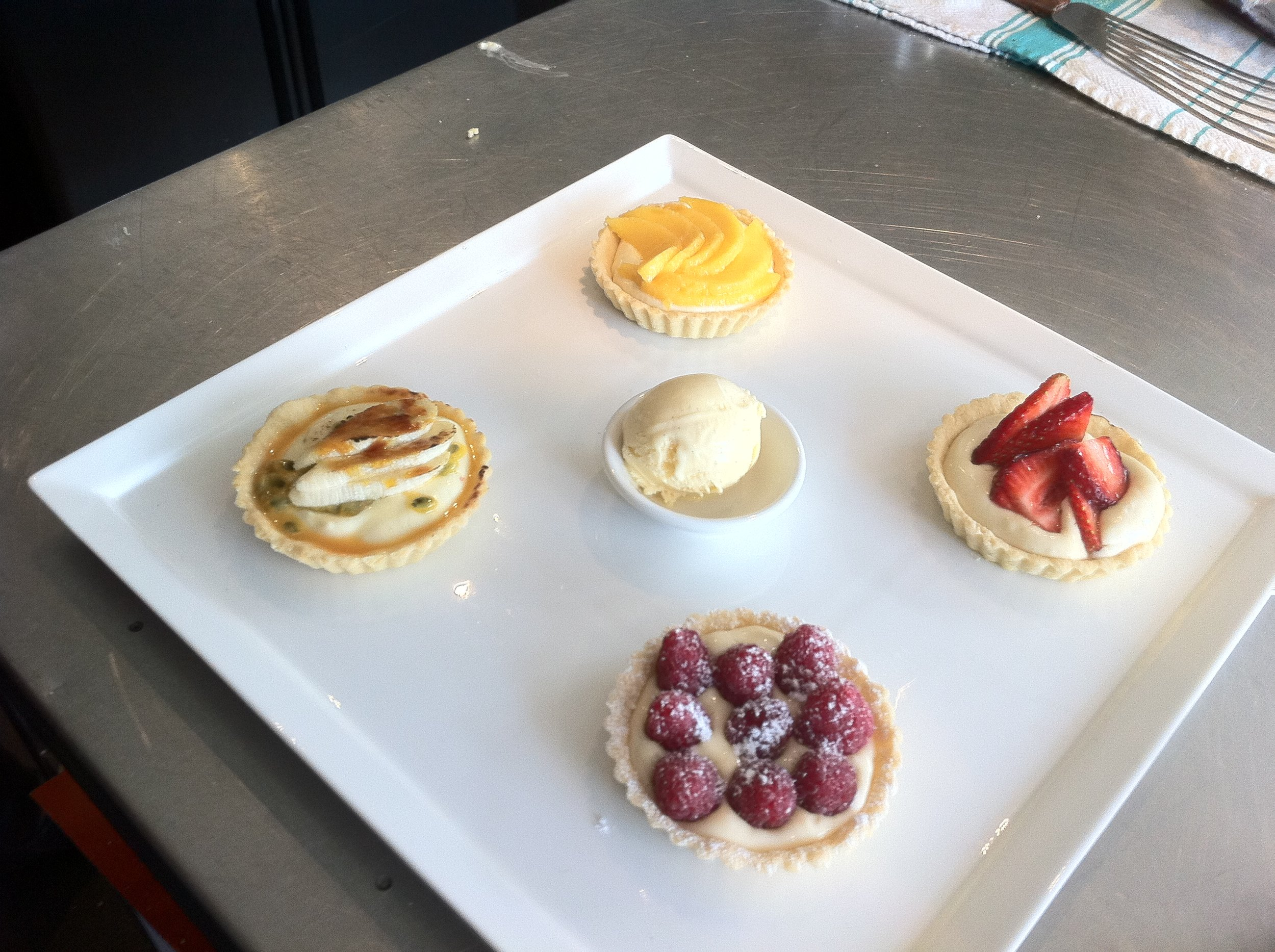 Four small sweet tarts