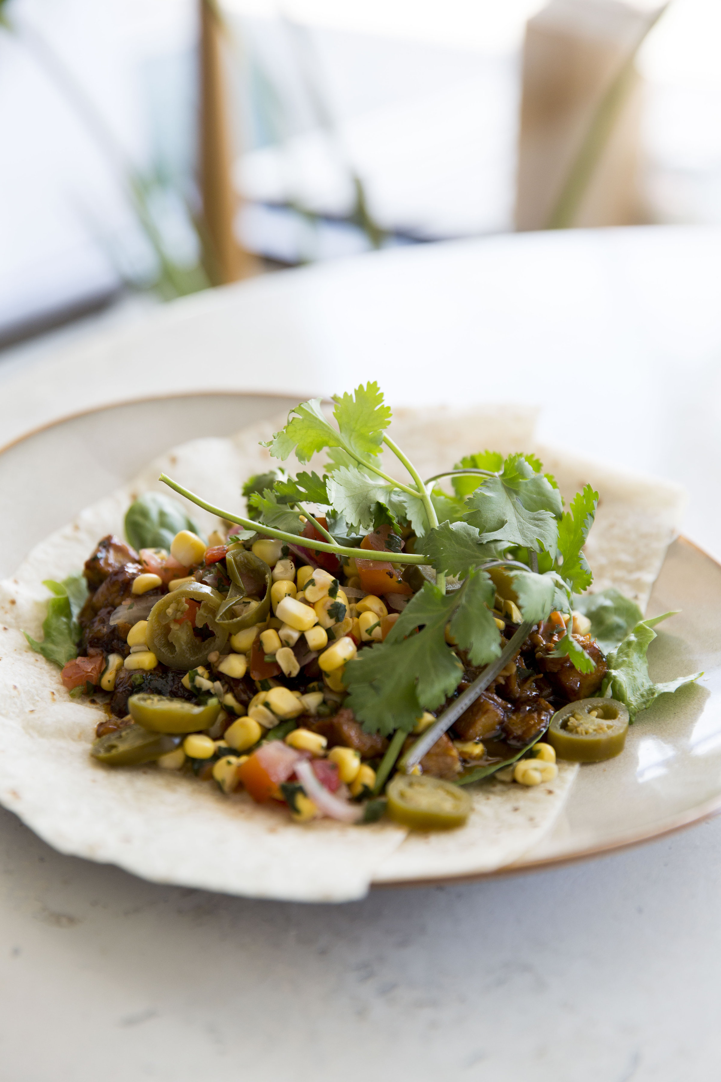 Pulled pork with charred corn, beans and jalapeño