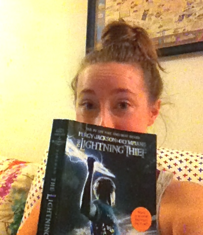 Me reading my thrift store scavenged copy of  The Lightning Thief .
