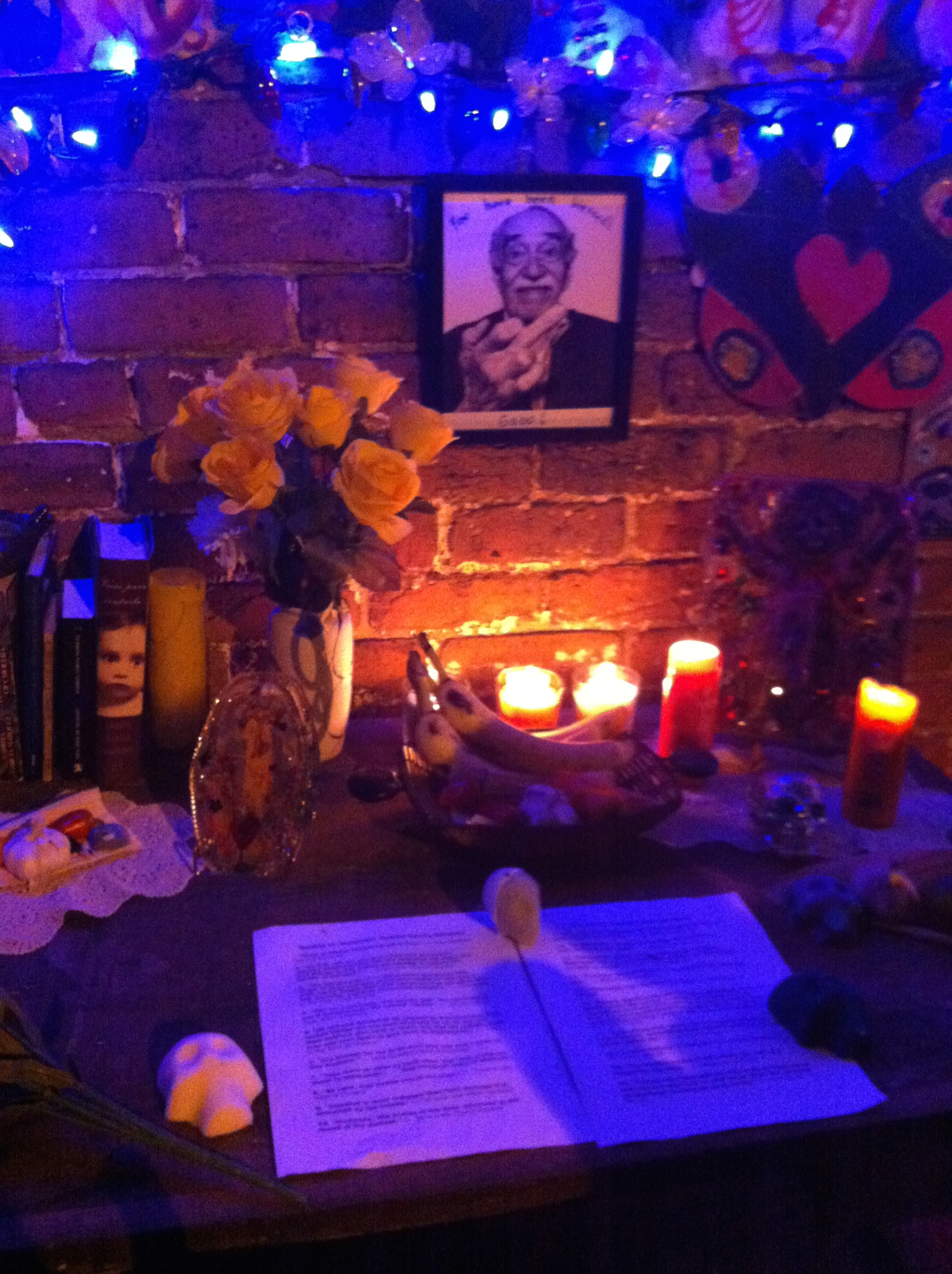 The ofrenda, or offering, to Gabriel Garcia Marquez at Dia de Los Muertos. The ofrenda consisted of a writing desk on which sat several of his books, candles, yellow roses, sugar skulls, pages of his quotes, and some of his favorite foods.