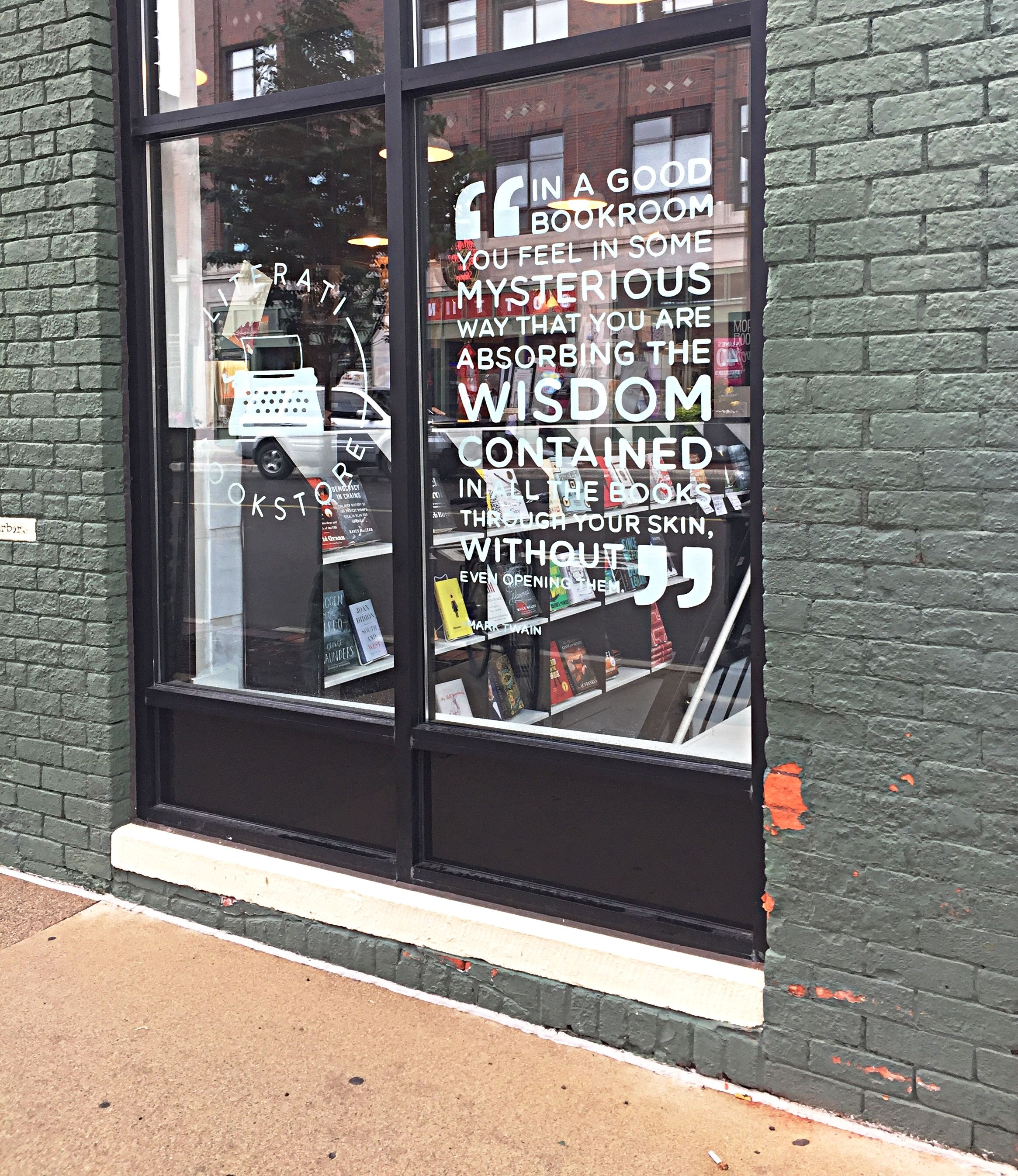 """The quote on the window is: """"In a good book room you feel in some mysterious way that you are absorbing the wisdom contained in all the books through your skin, even without opening them."""""""