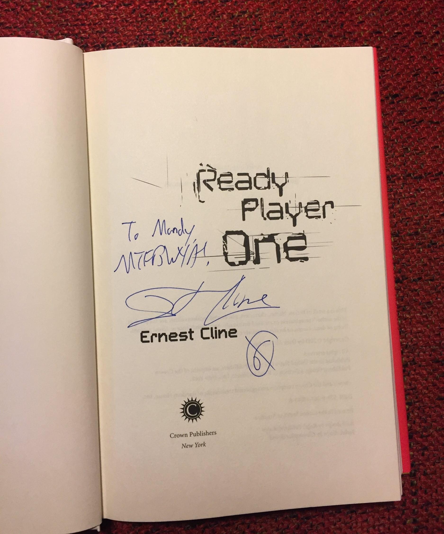 """[image description: the page in my copy of Ready Player One where the author signed the book. It says, """"To Mandy, MTFBWYA! - Ernest Cline."""" The MTFBWYA acronym stands for May the Force Be With You Always."""