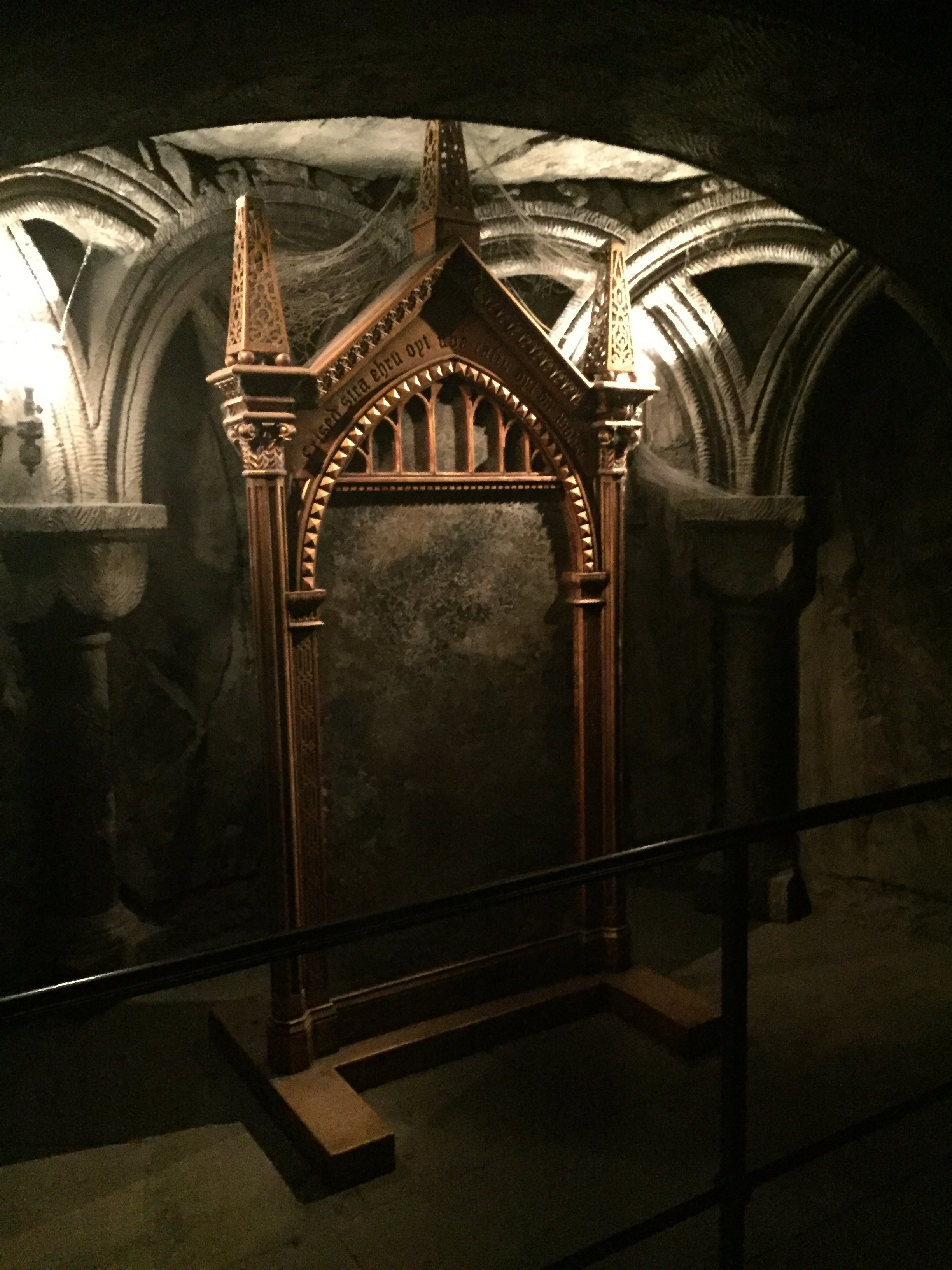 [image description: The Mirror of Erised. It's a floor length mirror in an ornate gold stand. There are cobwebs at the top.]