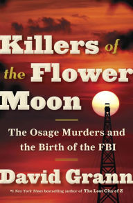 [image description: The cover of Killers of the Flower Moon. The background is a red sky sunset with a fire tower off to one side, blocking part of the sun.]