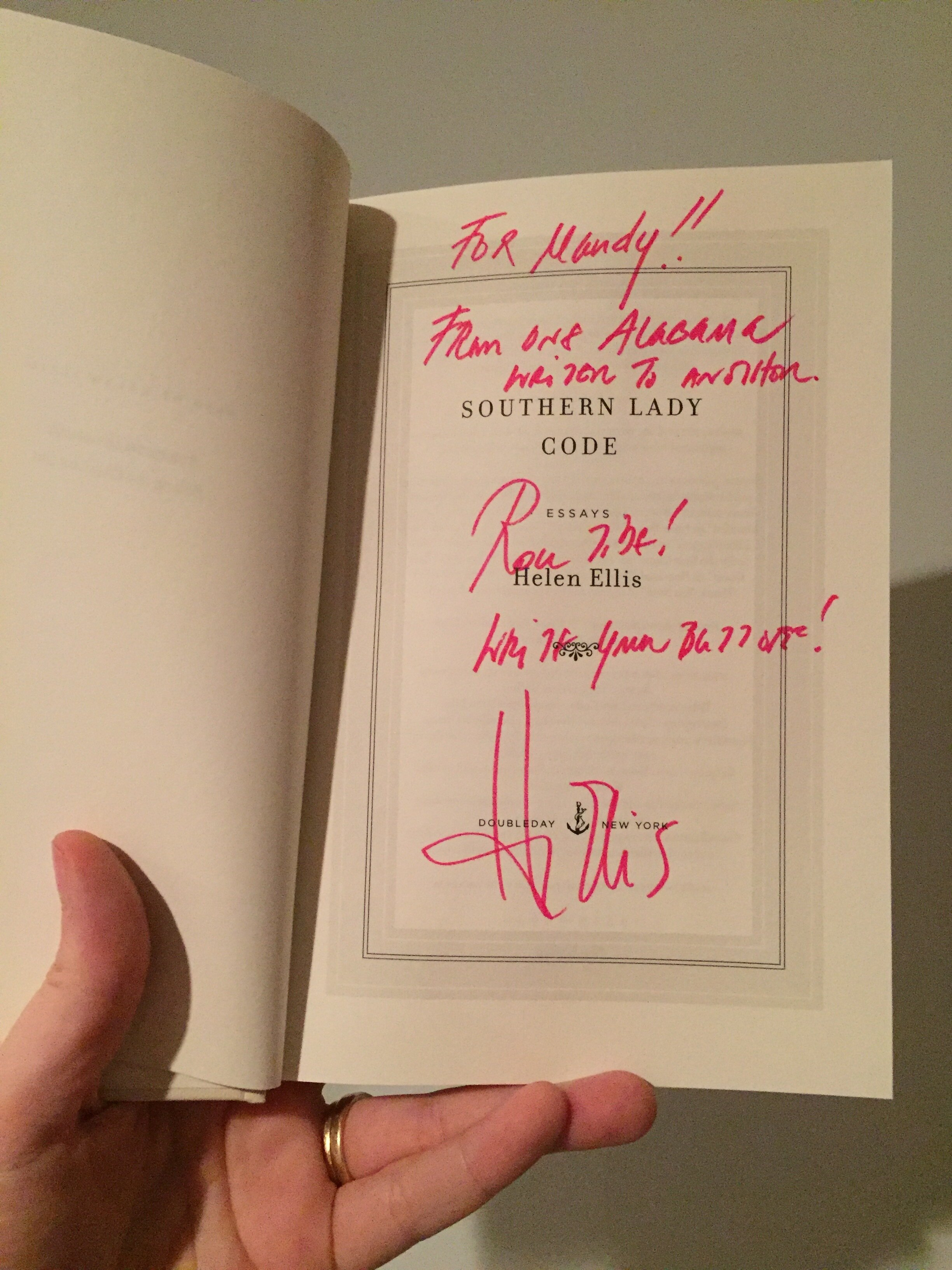 [image description: My copy of Helen's book Southern Lady Code open to the title page where she signed the book.]