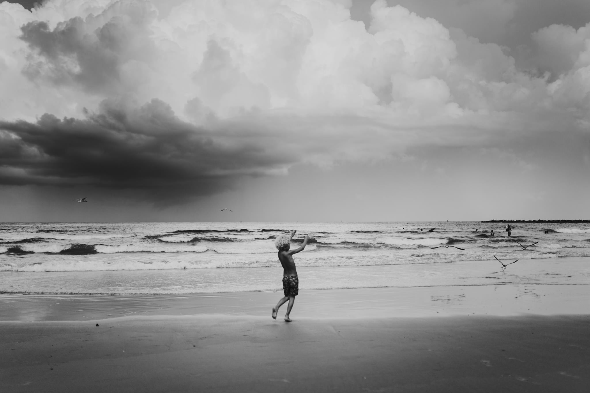 twyla jones photography - treasure coast florida - stormy beach boy playing in sand--4.jpg