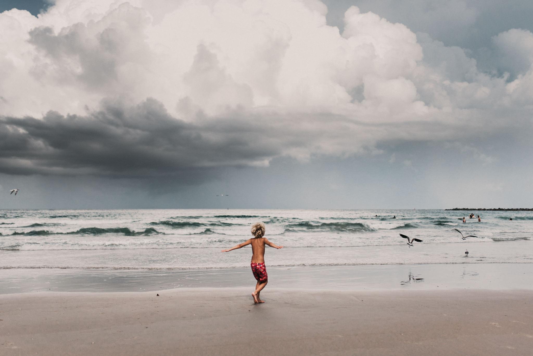 twyla jones photography - treasure coast florida - stormy beach boy playing in sand--3.jpg
