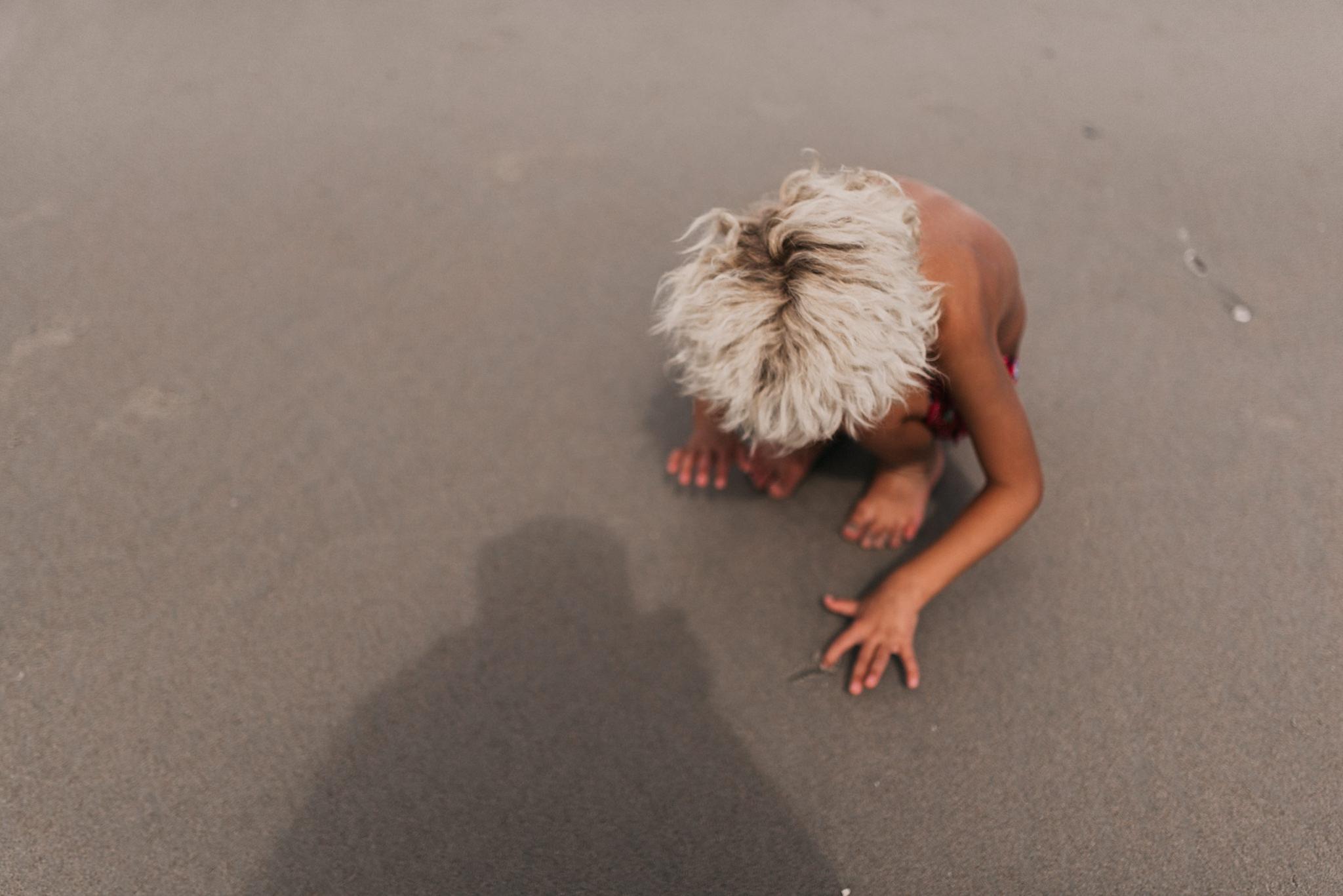 twyla jones photography - treasure coast florida - stormy beach boy playing in sand--8.jpg