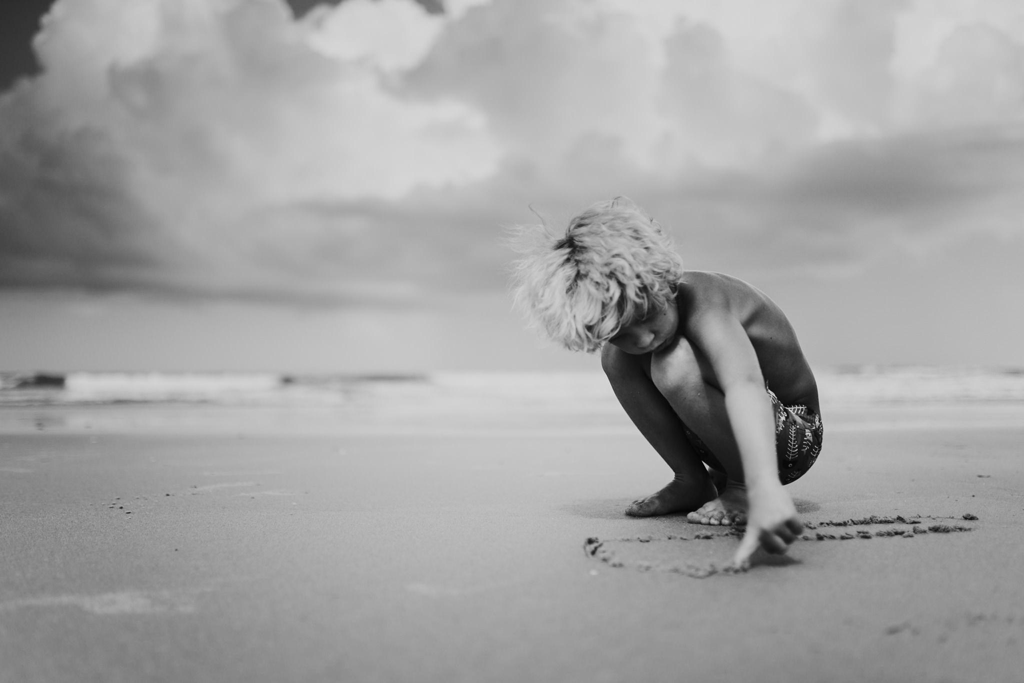 twyla jones photography - treasure coast florida - stormy beach boy playing in sand--9.jpg