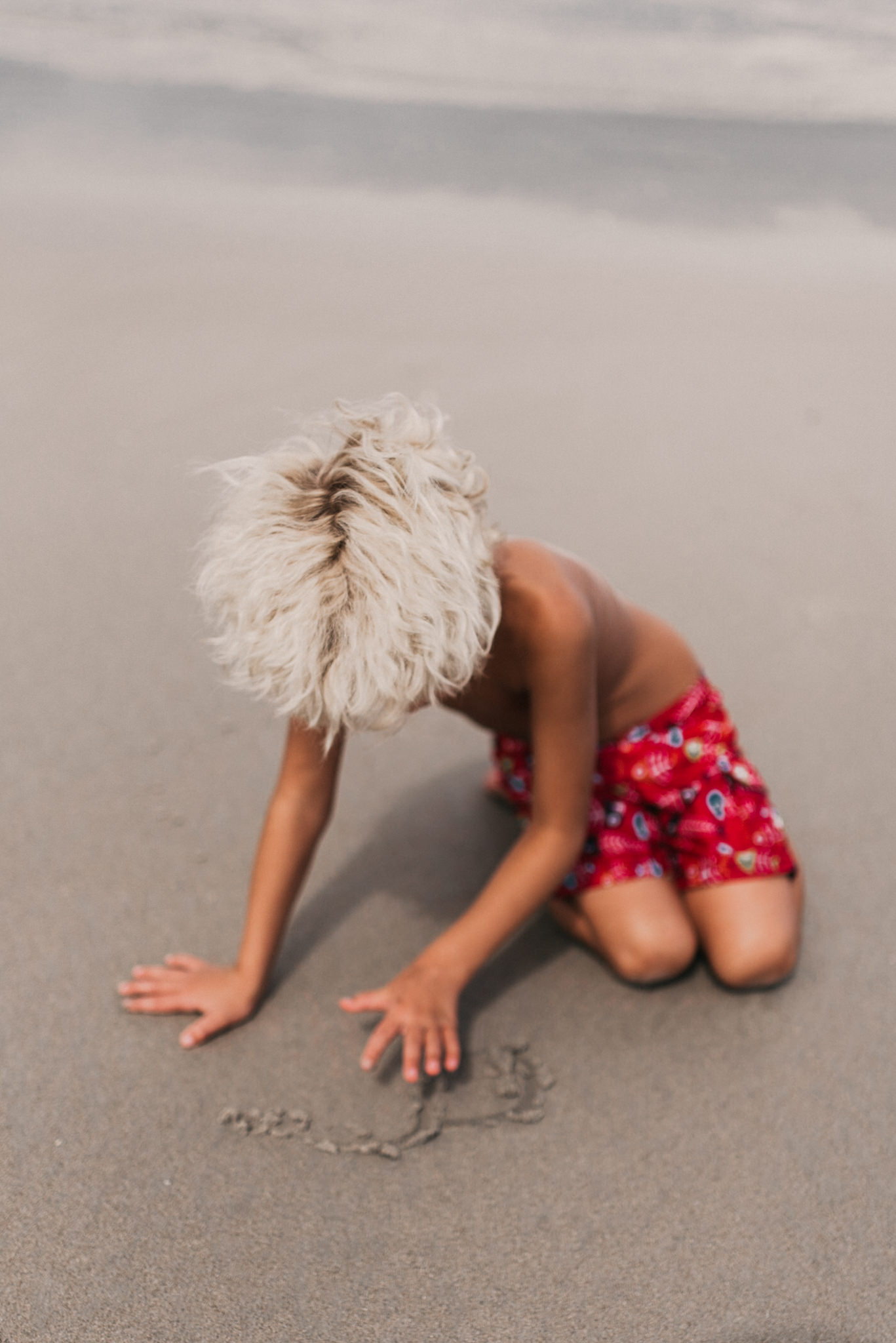 twyla jones photography - treasure coast florida - stormy beach boy playing in sand--11.jpg