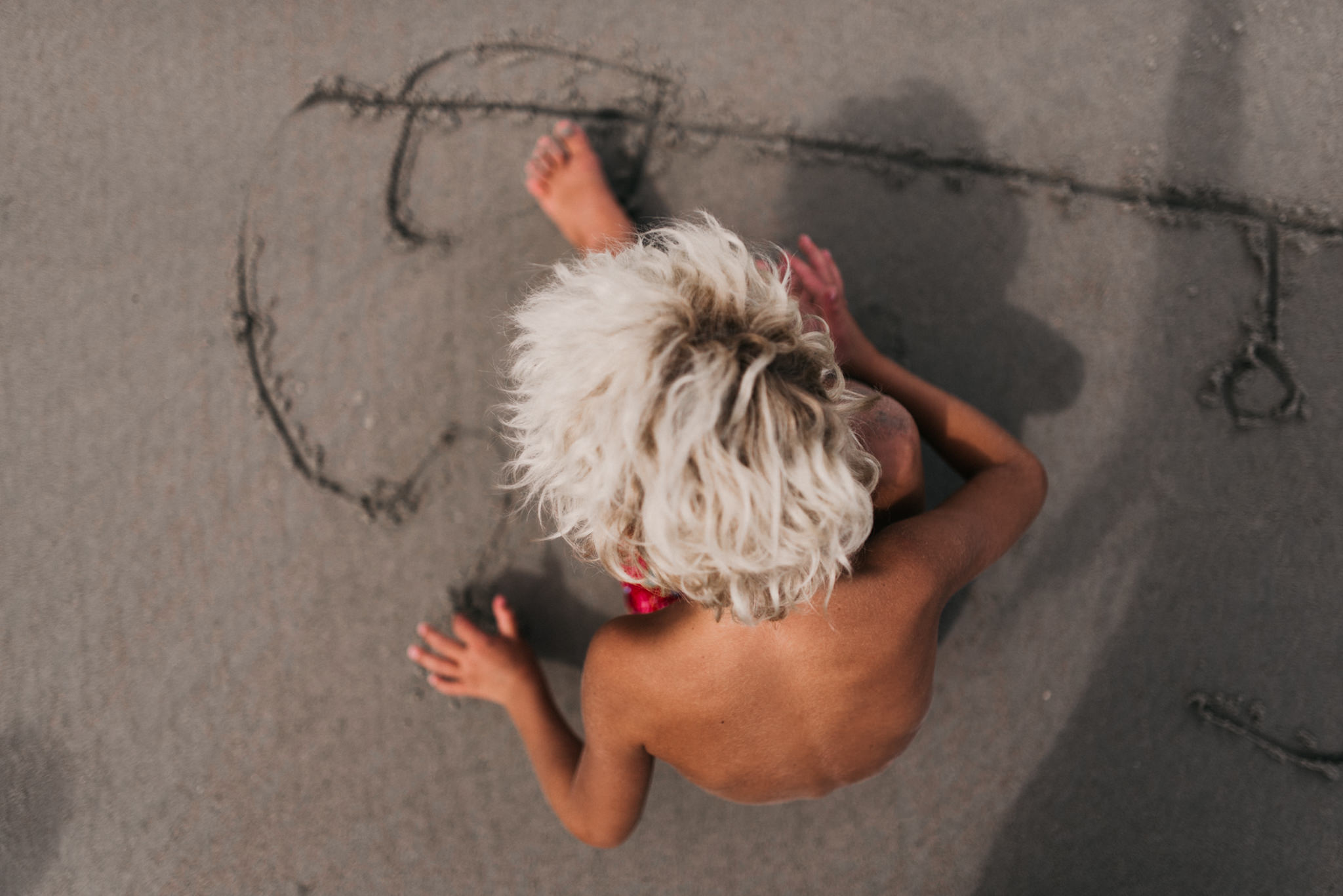 twyla jones photography - treasure coast florida - stormy beach boy playing in sand--14.jpg